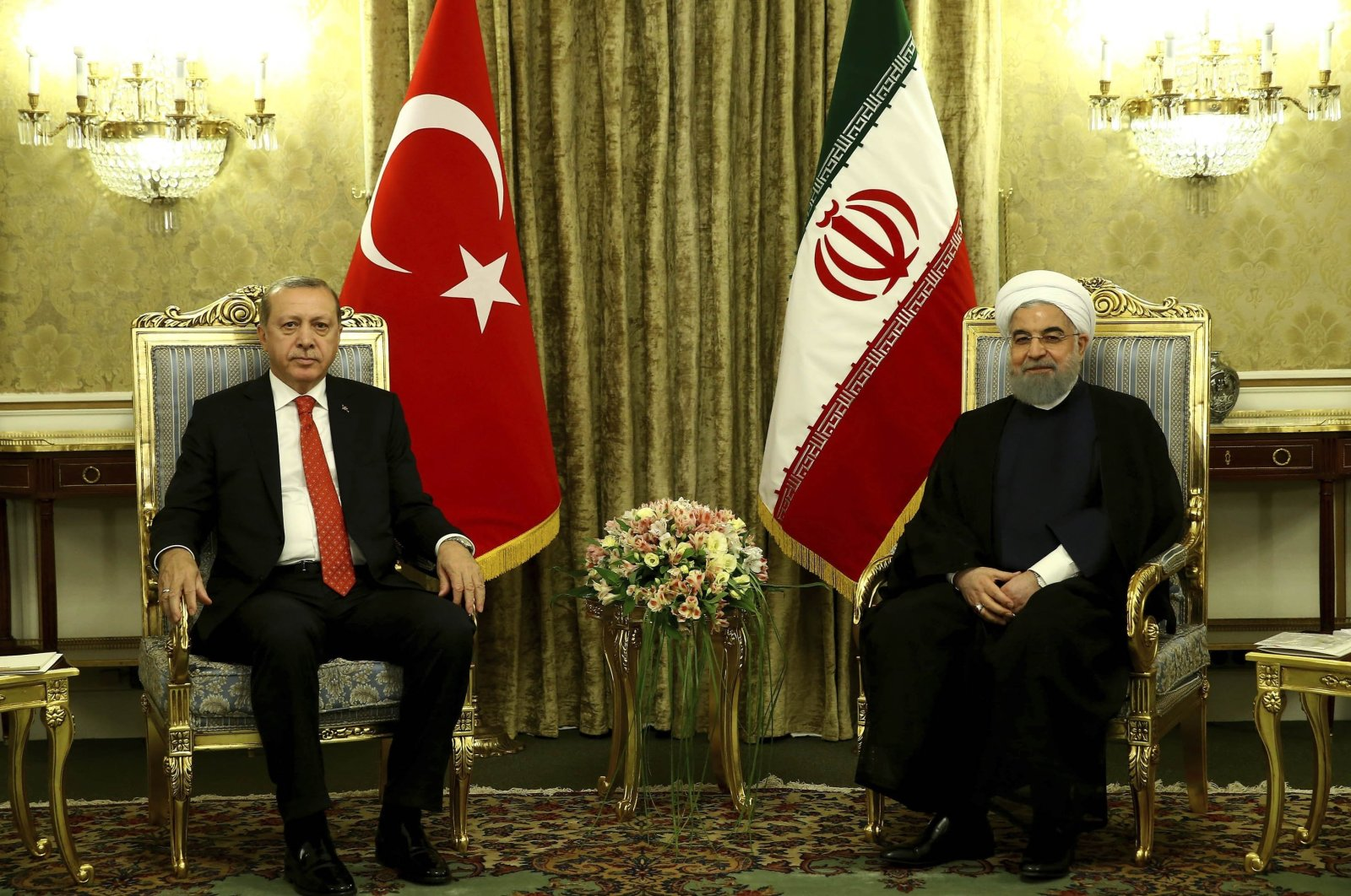 President Recep Tayyip Erdoğan (L) and Iranian President Hassan Rouhani are seen during a meeting in Tehran, Iran, Oct. 4, 2017. (AP Photo)