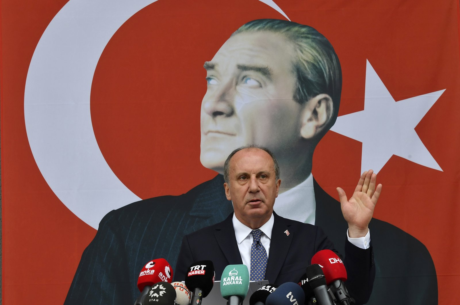 Muharrem Ince, a politician who once ran as a presidential challenger to Turkish President Recep Tayyip Erdoğan, speaks in front of a poster of modern Turkey's founder, Mustafa Kemal Atatürk, during a news conference in Ankara, Turkey, Monday, Feb. 8, 2021. (AP File Photo)