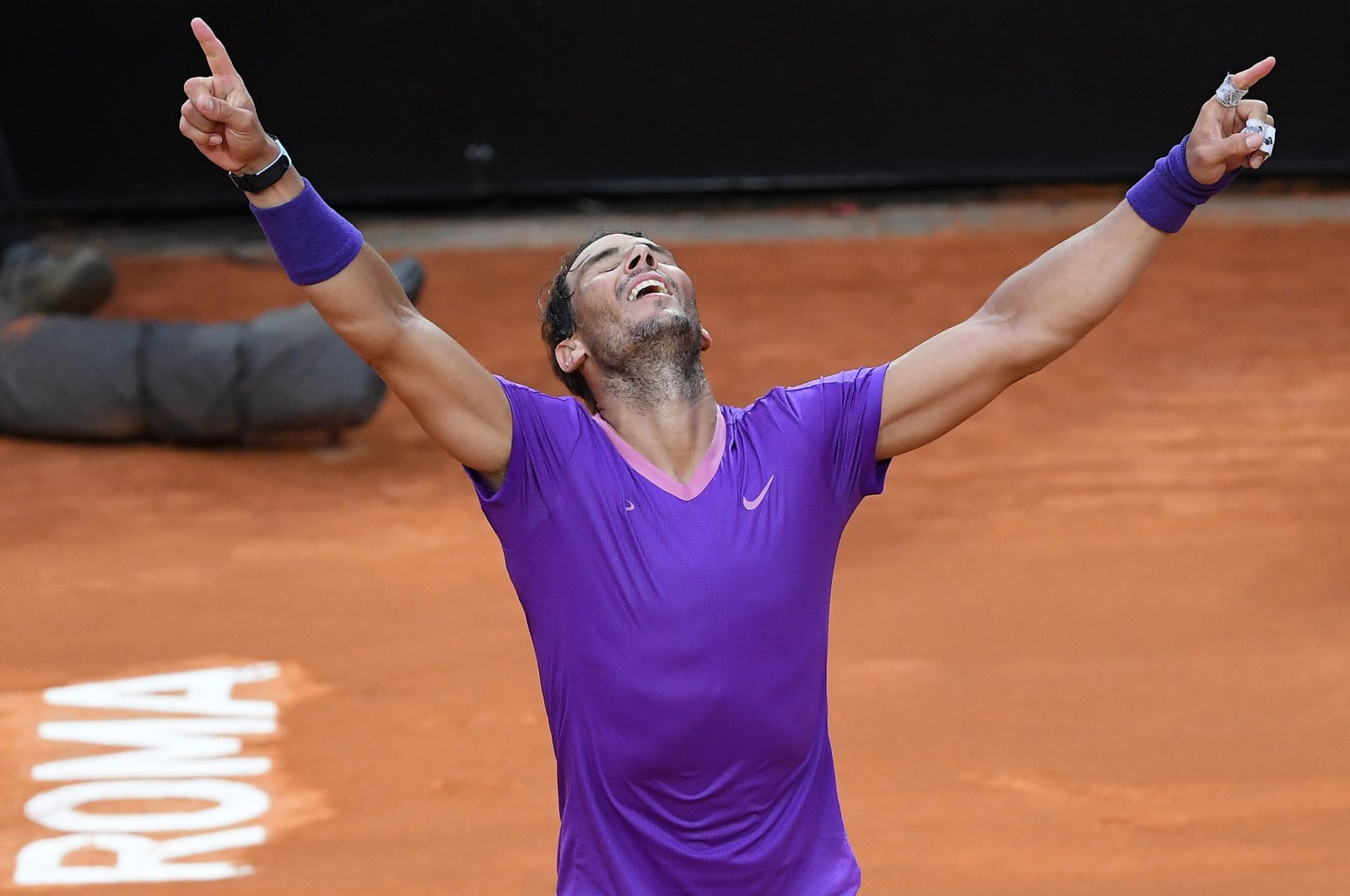 Rafael Nadal of Spain celebrates after winning his men's singles final against Novak Djokovic of Serbia at the Italian Open tennis tournament in Rome, Italy, May 16, 2021.  (EPA Photo)