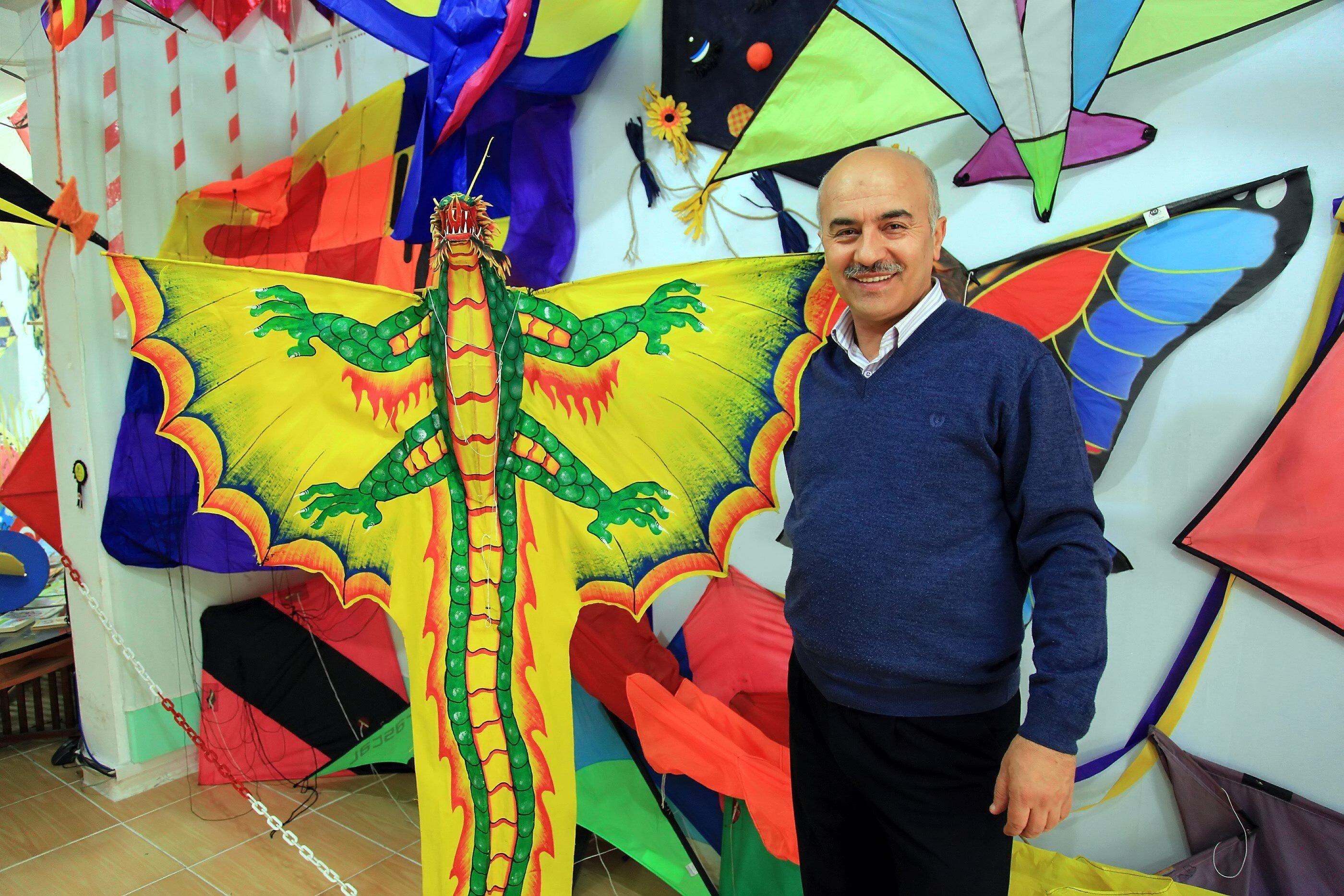 Mehmet Naci Aköz poses with a kite in the Istanbul Kite Museum, Istanbul, Turkey. (Sabah File Photo)