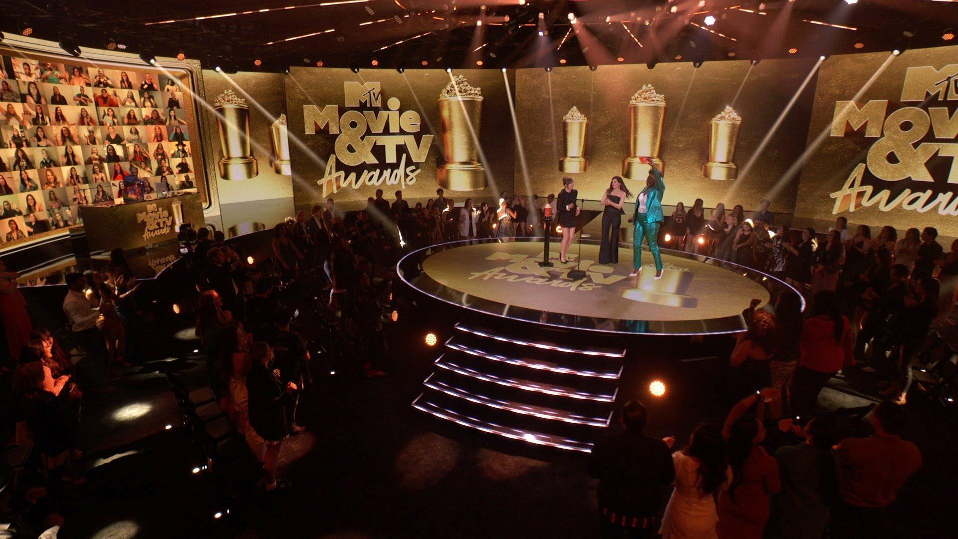 Elizabeth Olsen, Kathryn Hahn and host Leslie Jones are seen onstage during the 2021 MTV Movie & TV Awards in Los Angeles, California, U.S., May 16, 2021. (Viacom via Reuters)