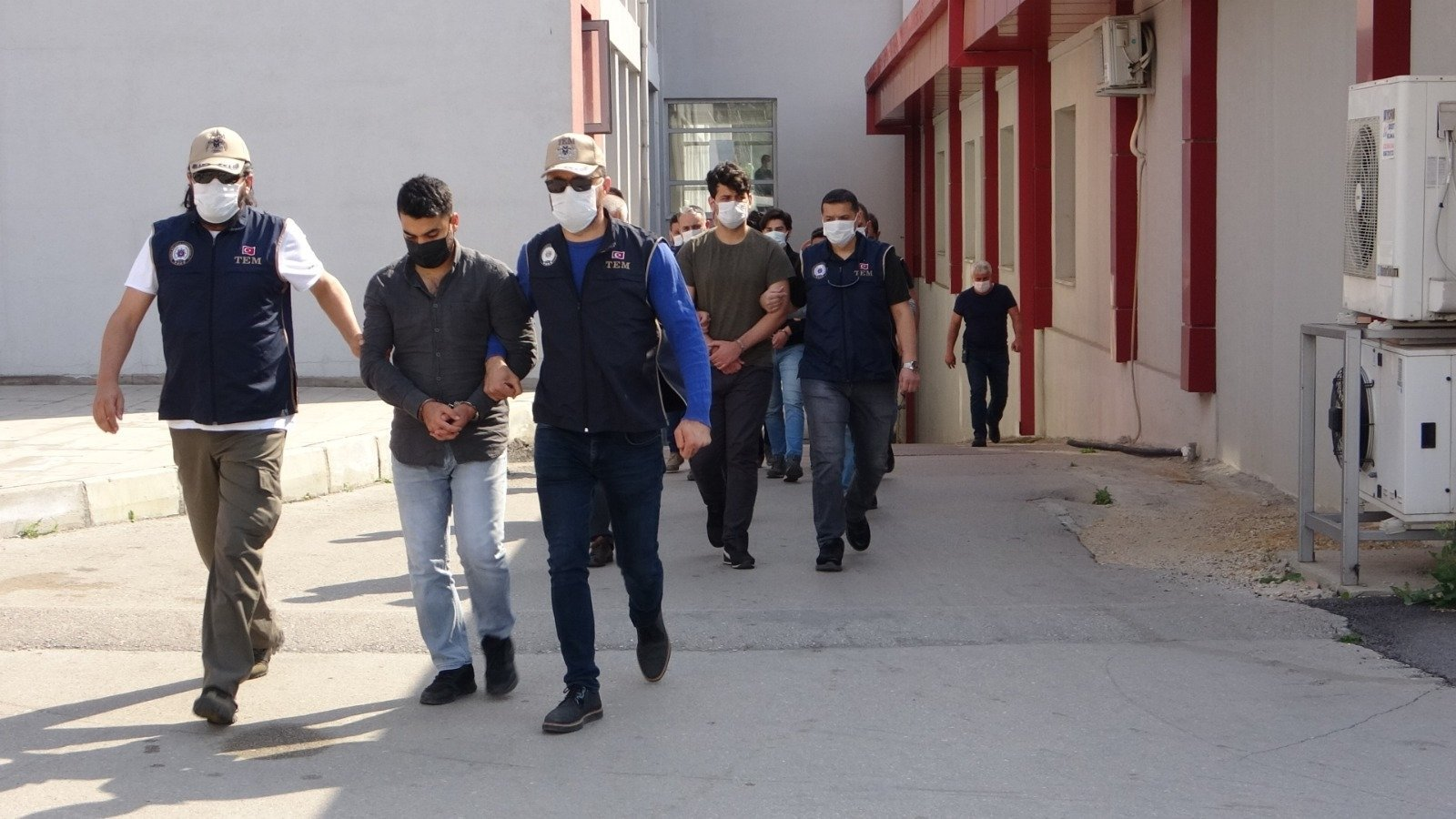Police escort suspects captured in southern Adana province, Turkey, April 26, 2021. (DHA PHOTO)