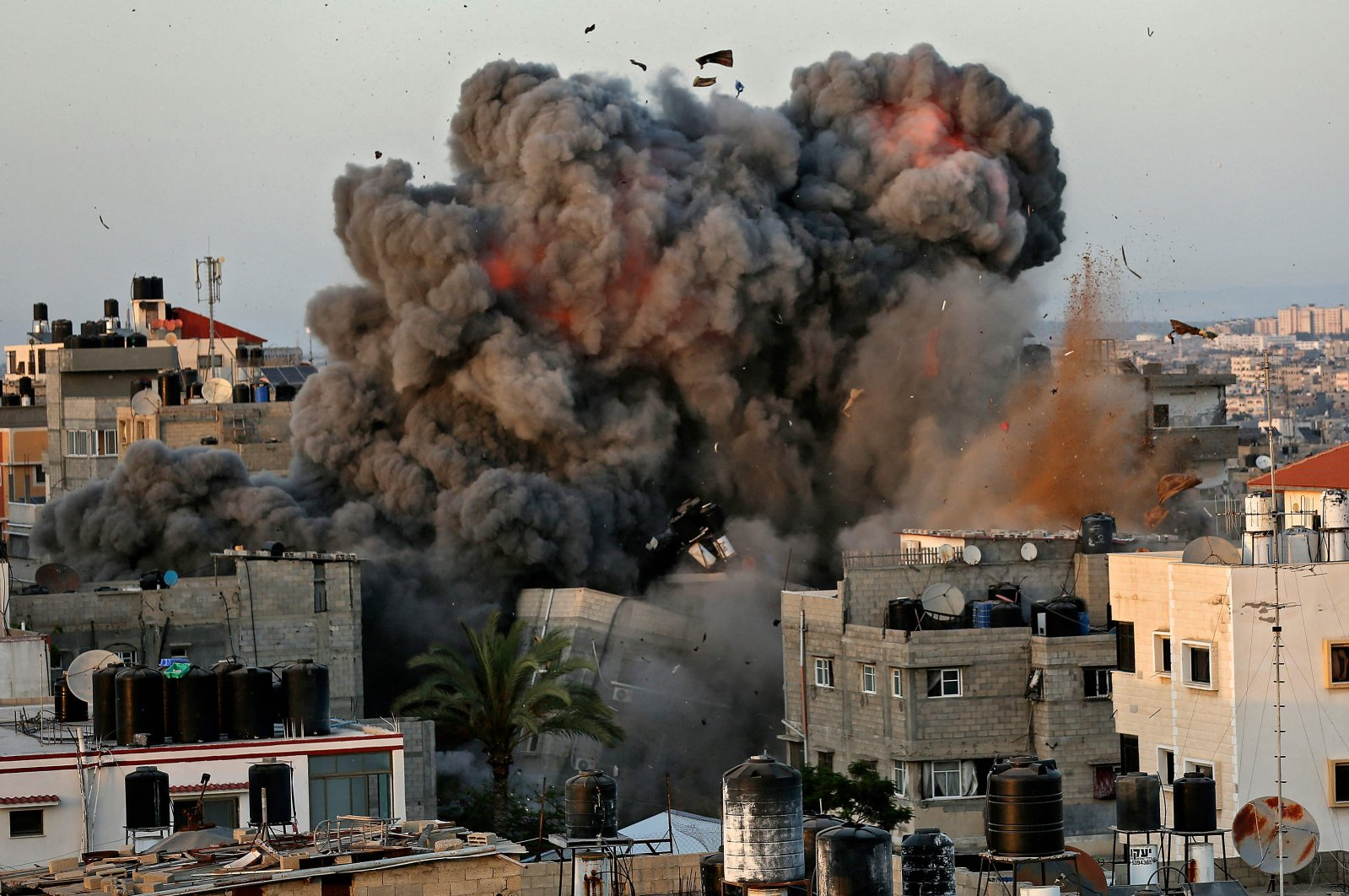A ball of fire and thick smoke erupts following an Israeli bombardment on a building in Gaza City's Rimal residential district, Palestine, May 16, 2021. (AFP Photo)
