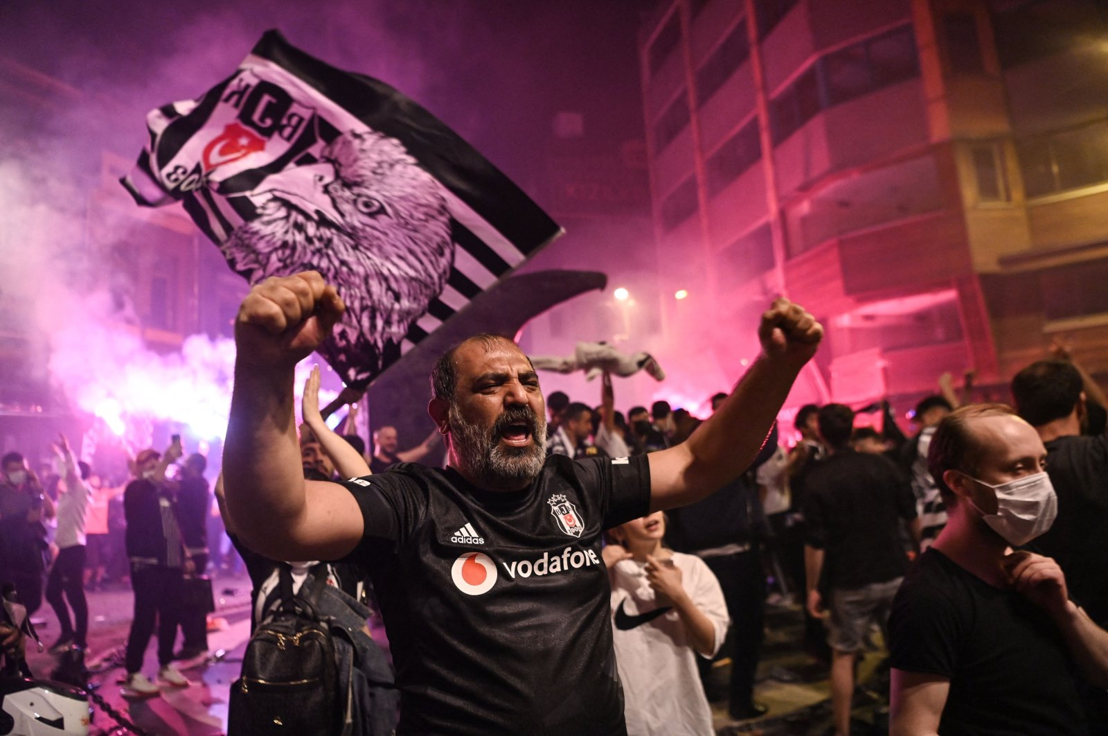 Smoke rises from flares as Beşiktaş' fans celebrate after winning the Turkish Super League Championship after the last match of the season on late May 15, 2021 at Beşiktaş district in Istanbul. (AFP Photo)