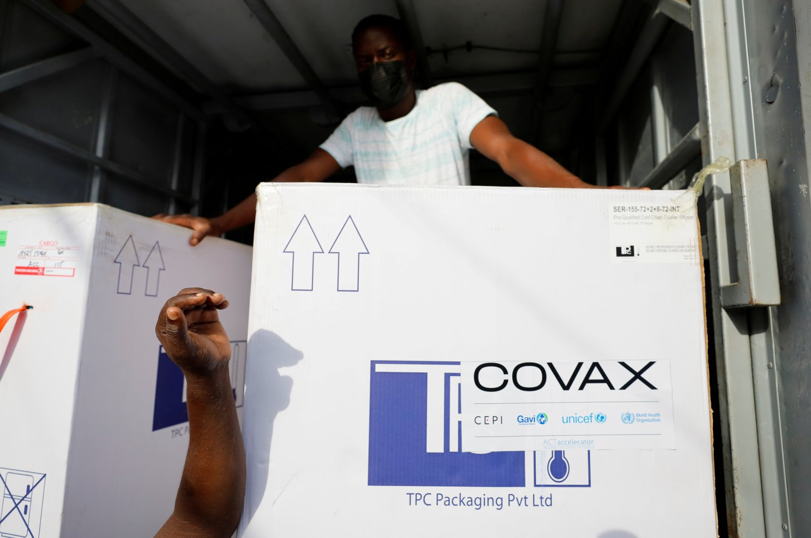 Boxes of AstraZeneca-Oxford coronavirus vaccines, redeployed from the Democratic Republic of Congo, arrive at a cold storage facility in Accra, Ghana, May 7, 2021. (Reuters Photo)