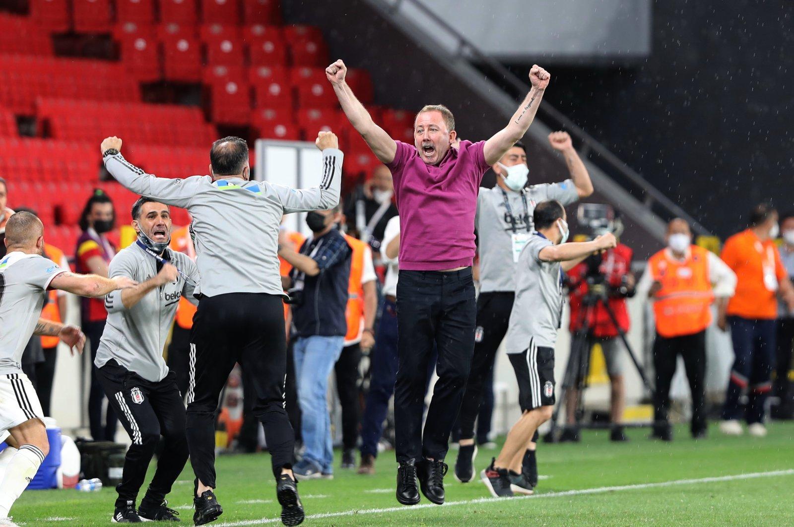 Beşiktaş coach Sergen Yalçın (C) and support staff celebrate winning the Turkish Süper Lig title, Izmir, Turkey, May 15, 2021. (AA Photo)