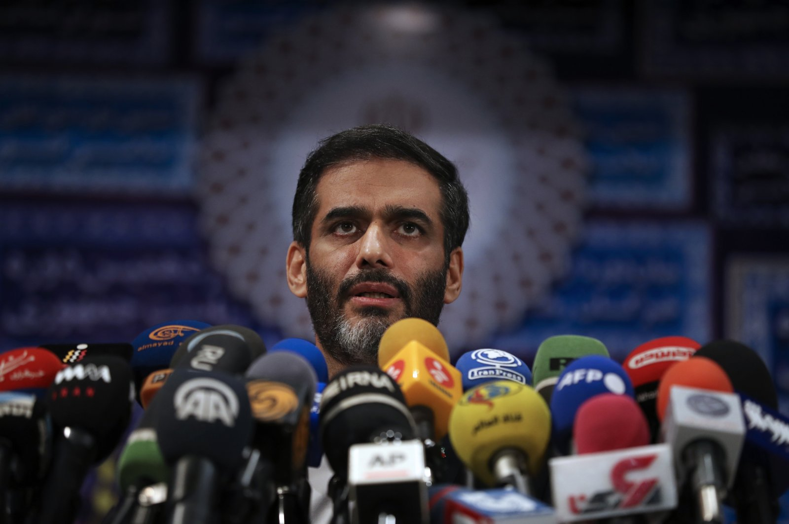 Saeed Mohammad speaks with the media after registering his name as a candidate for the presidential elections in Tehran, Iran, May 11, 2021. (AP Photo)