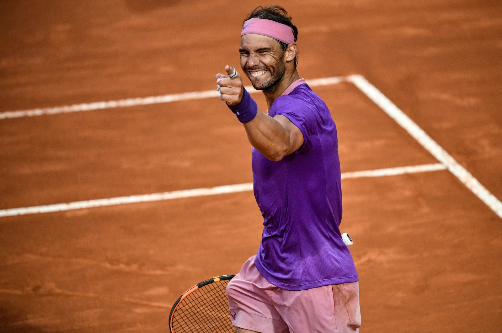 Spain's Rafael Nadal celebrates after defeating Serbia's Novak Djokovic in the Italian Tennis Open men's final, Rome, Italy, May 16, 2021. (AFP Photo)