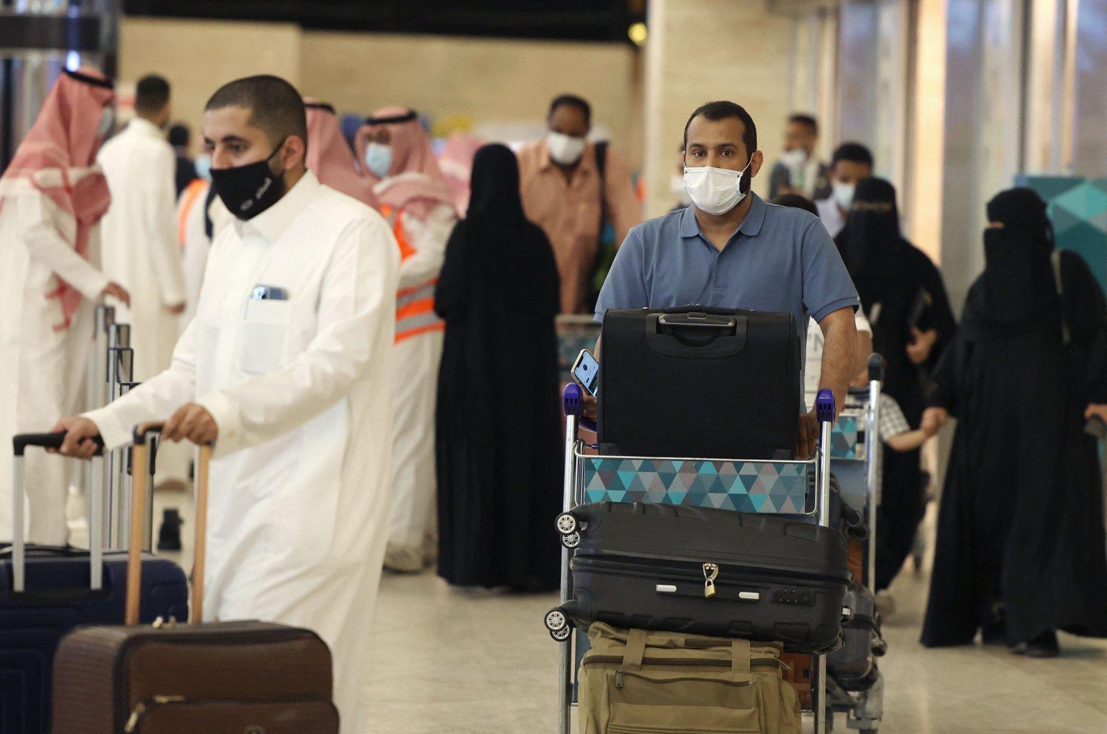 Saudi passengers arrive at King Khaled International airport in the capital Riyadh as Saudi authorities lift travel restrictions for citizens immunized against COVID-19, Riyadh, Saudi Arabia, May 17, 2021. (AFP Photo)