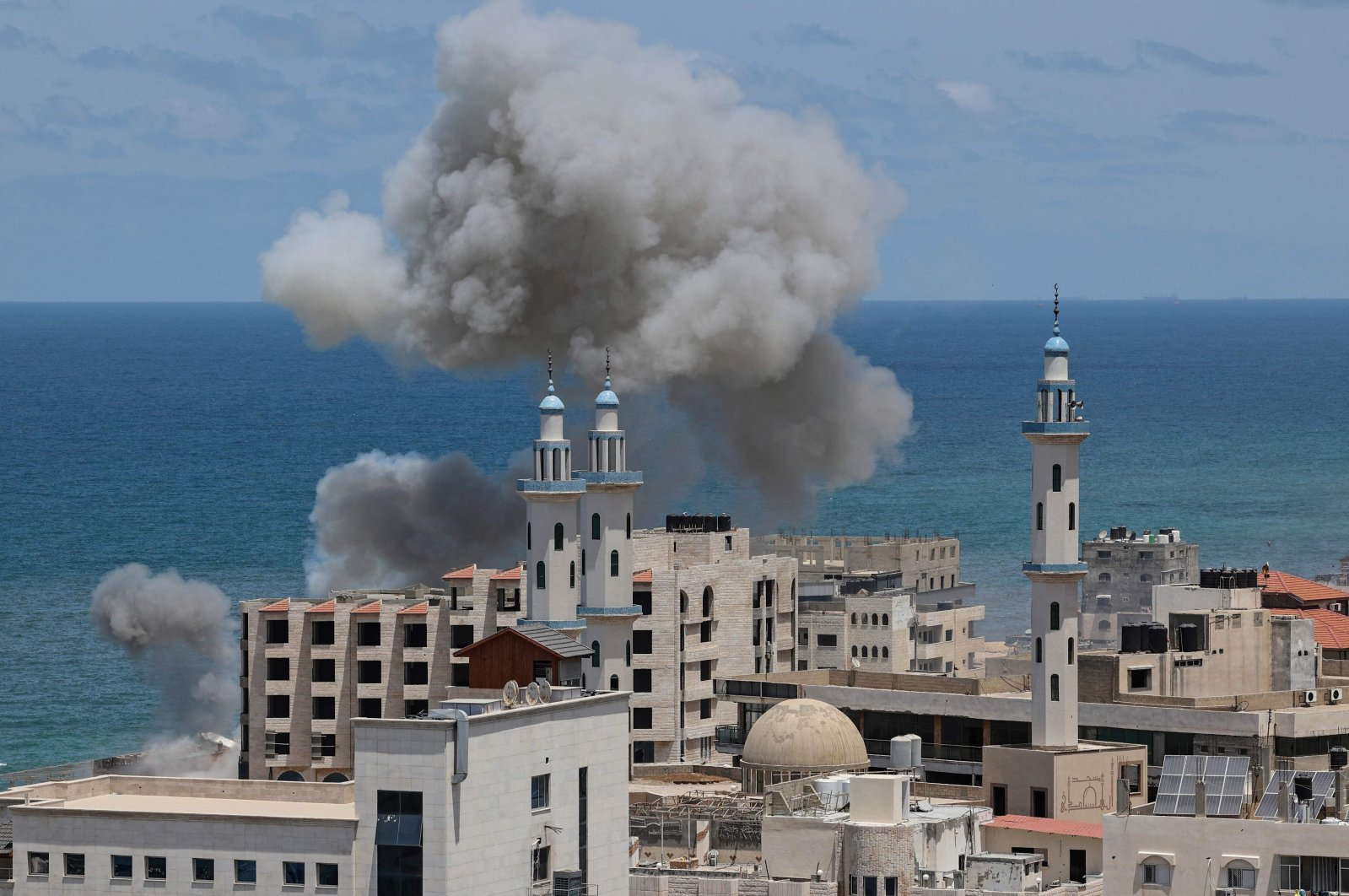 Smoke billows from the port of Gaza City following an Israeli bombardment from the sea, the Gaza Strip, Palestine, May 17, 2021. (AFP Photo)