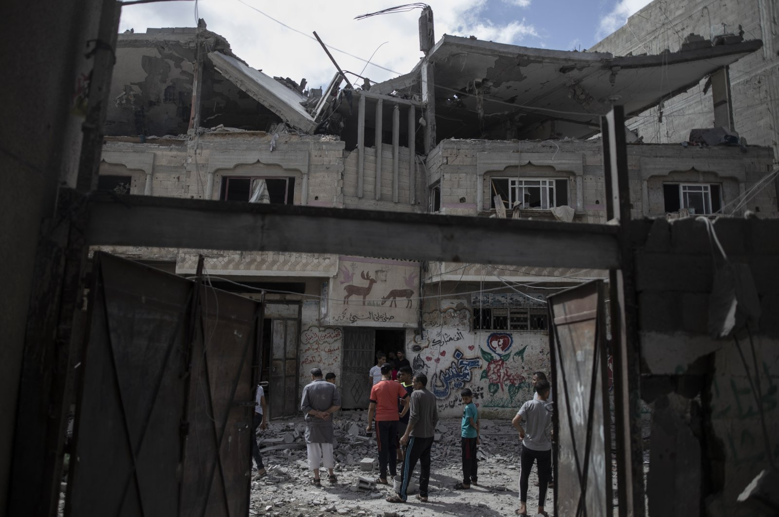 Palestinians inspect a damaged house that was hit by early morning Israeli airstrikes, in Gaza City, Palestine, May 17, 2021. (AP Photo)