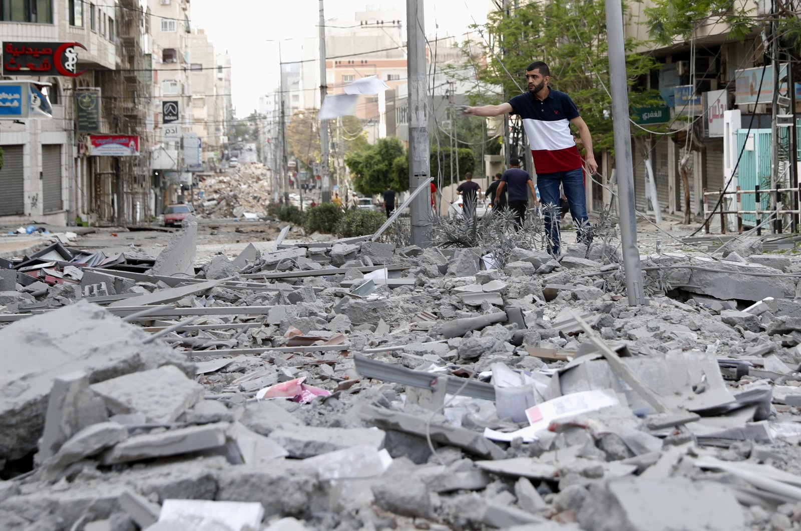 A man inspects the rubble following an Israeli airstrike on the upper floors of a commercial building near the Palestinian Health Ministry in Gaza City, Palestine, Monday, May 17, 2021. (AP Photo)