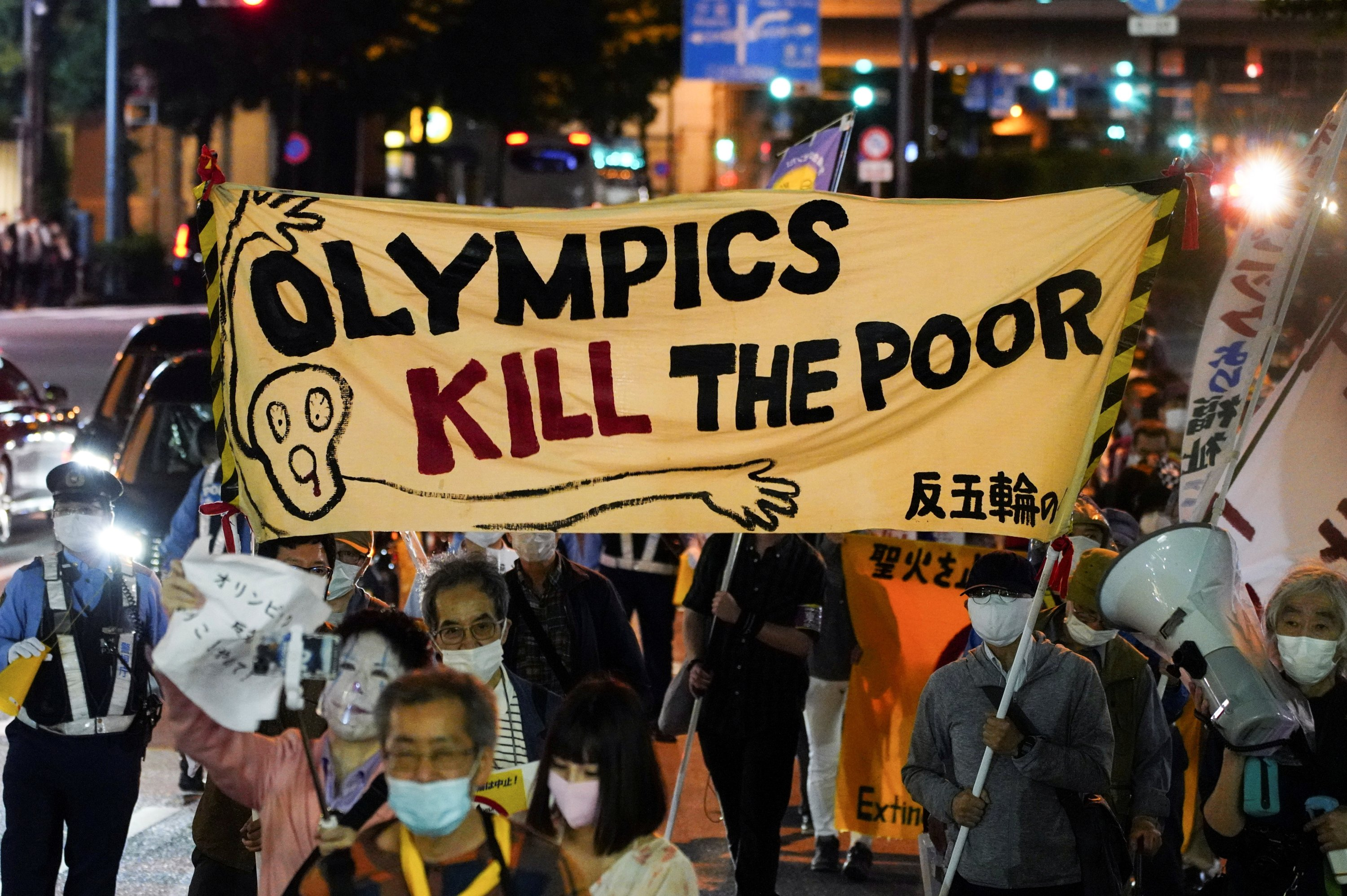 Anti-Olympics group members carry banners during a protest march, amid the COVID-19 outbreak, Tokyo, Japan, May 17, 2021. (Reuters Photo)