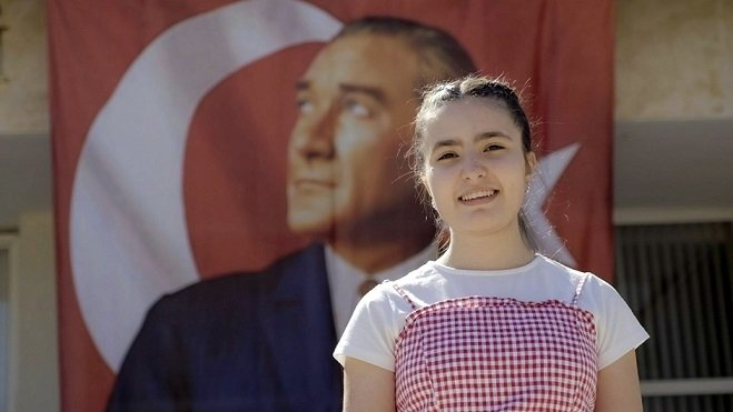 A university student poses in front of a poster of Mustafa Kemal Atatürk, the founder of the Republic of Turkey, in Istanbul, Turkey, May 18, 2021. (DHA Photo)
