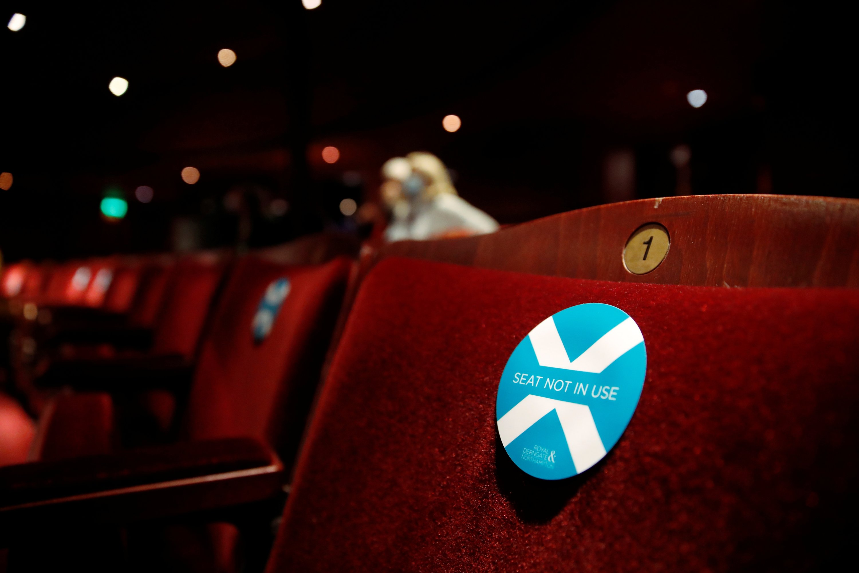 A sticker is pictured on an empty seat at the Royal & Derngate ahead of the start of the National Youth Theatre's co-production of 'Animal Farm' as COVID-19 restrictions continue to ease, in Northampton, U.K., May 17, 2021. (Reuters Photo)