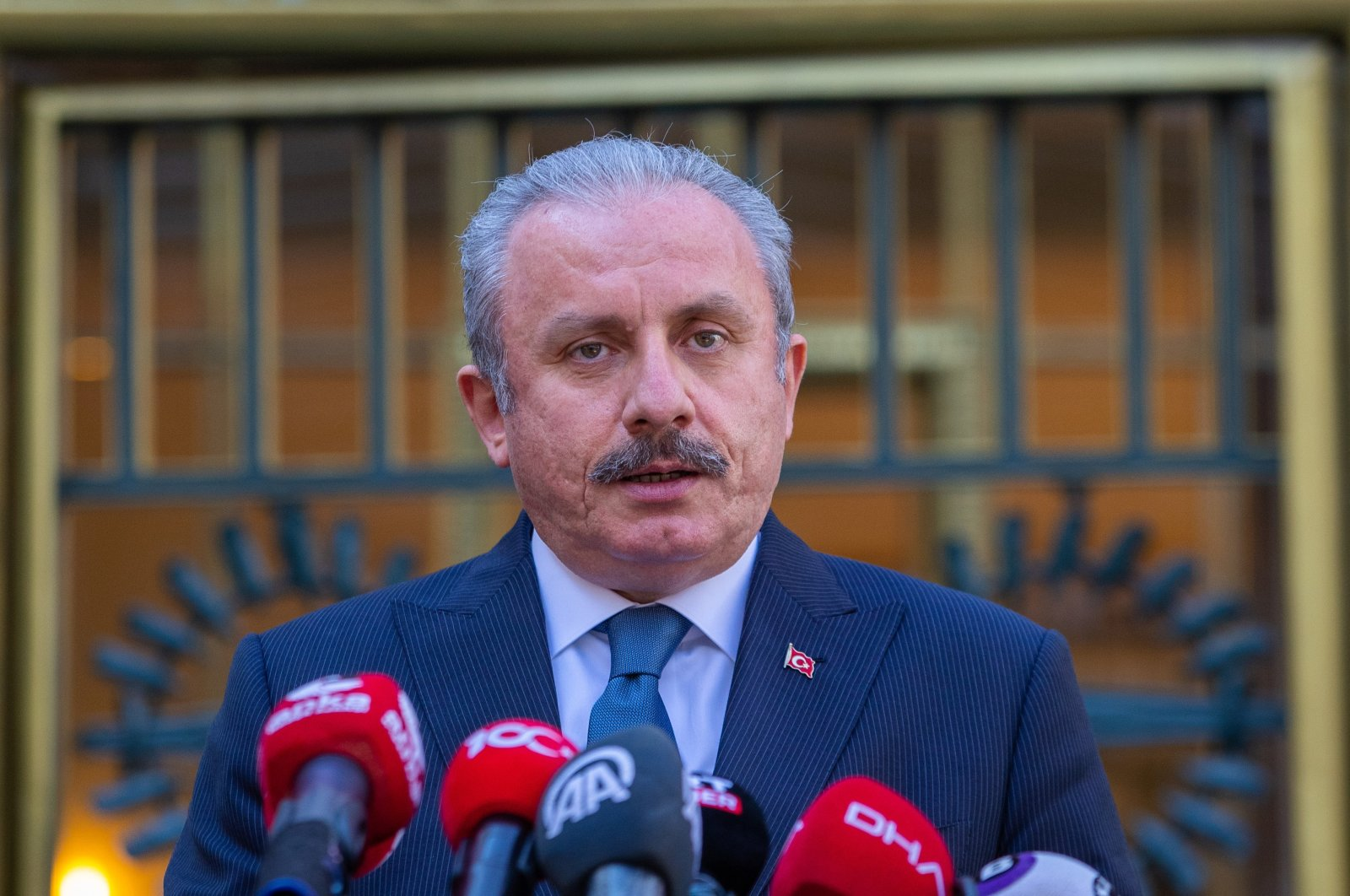 Turkey's Parliament Speaker Mustafa Şentop speaks to reporters at a news conference in front of the parliament in Ankara, Turkey, April 20, 2021. (Sabah Photo)