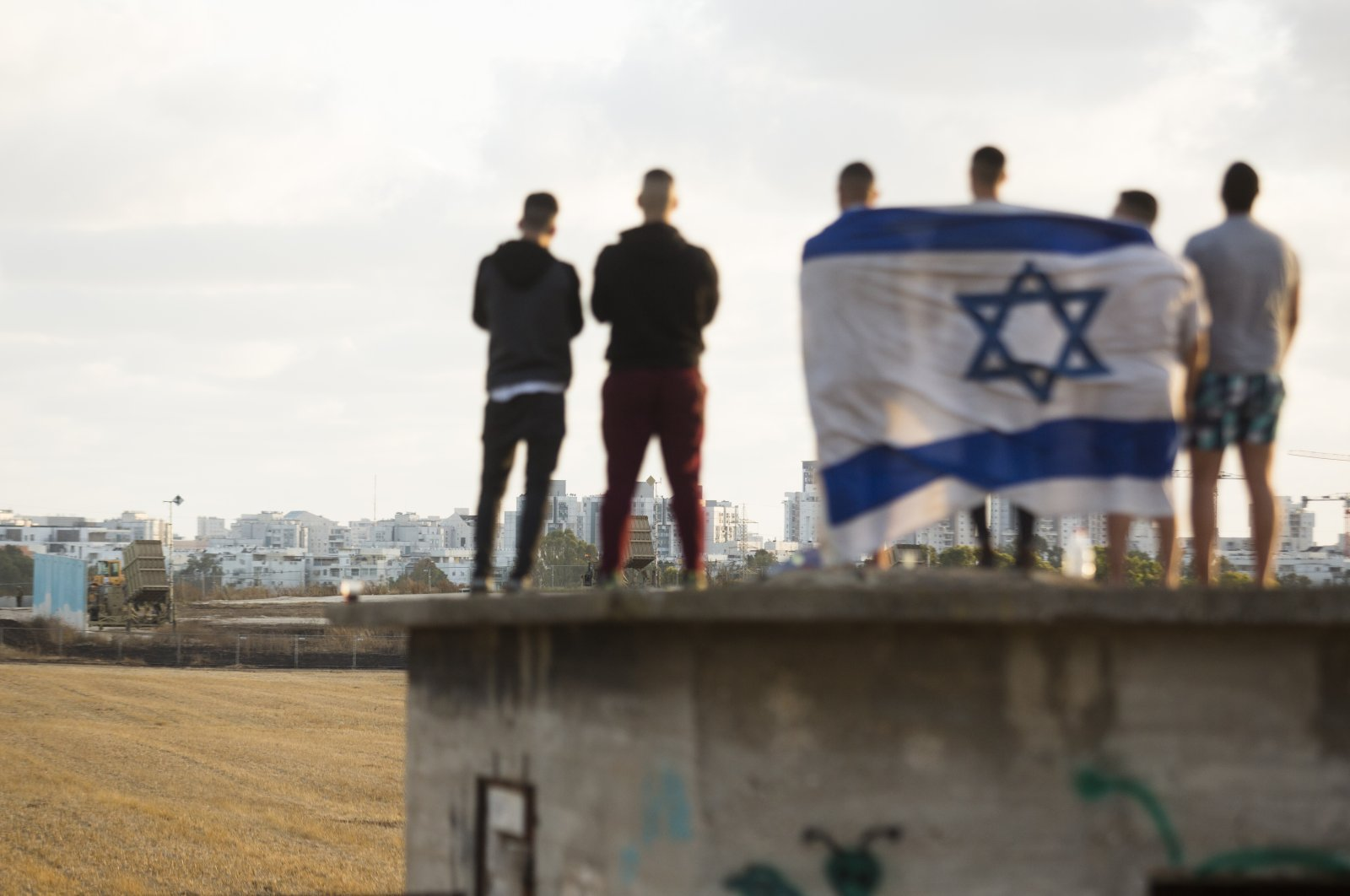 Israelis gather to watch the Iron Dome missile defense system intercept rocket fire amid Israeli attacks against Gaza, in Ashdod, Israel, May 17, 2021. (Photo by Getty Images)