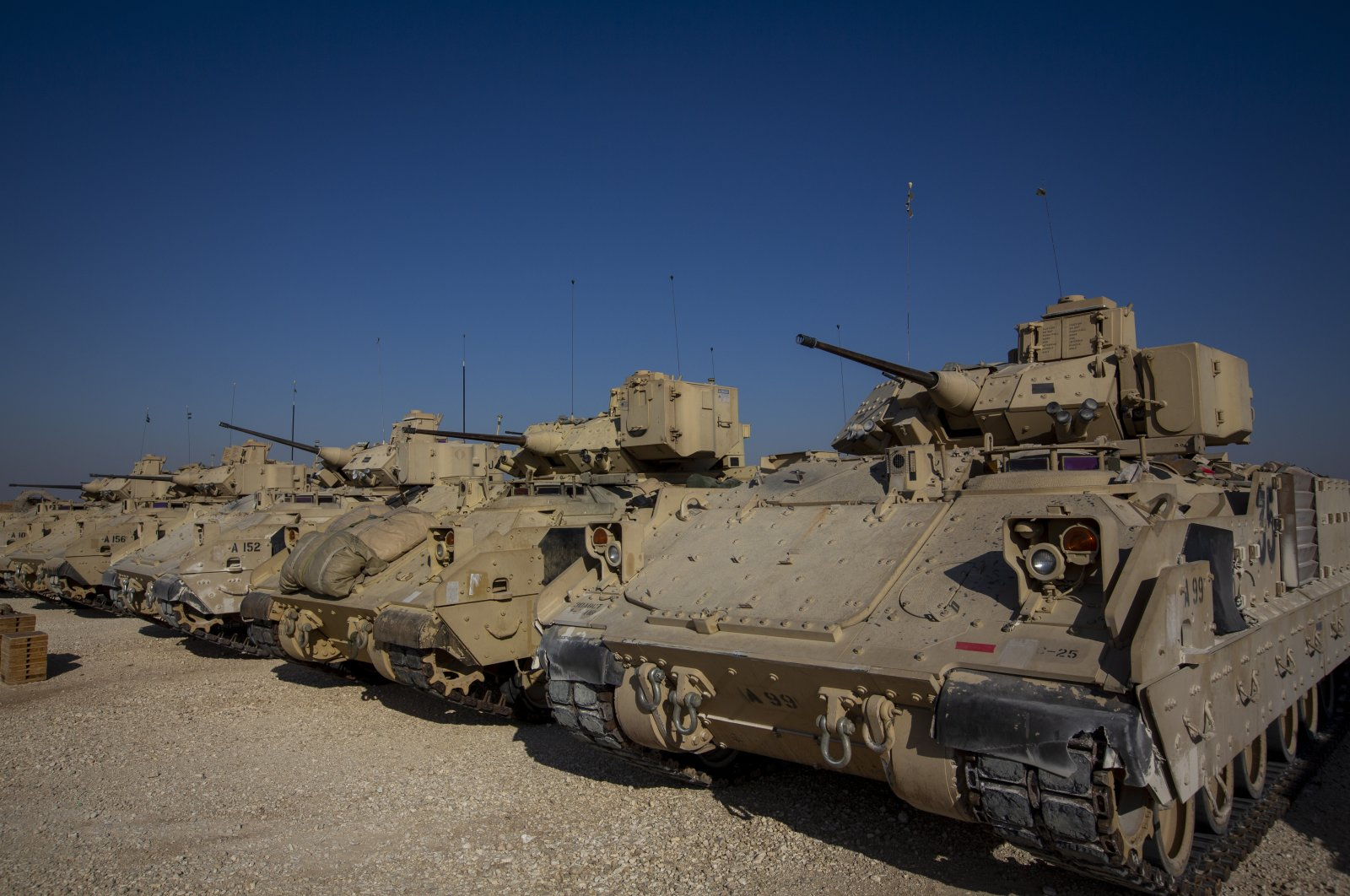 Bradley fighting vehicles are parked at a U.S. military base at an undisclosed location in northeastern Syria, Nov. 11, 2019. (AP File Photo)
