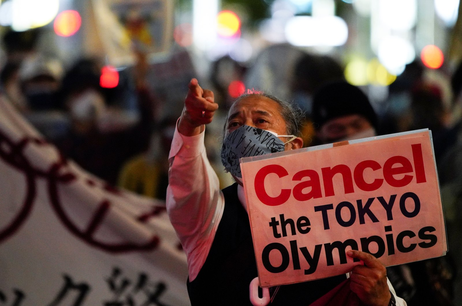 An anti-Olympics group member gestures as he holds a sign during a protest march, amid the COVID-19 outbreak, in Tokyo, Japan, May 17, 2021. (Reuters Photo)