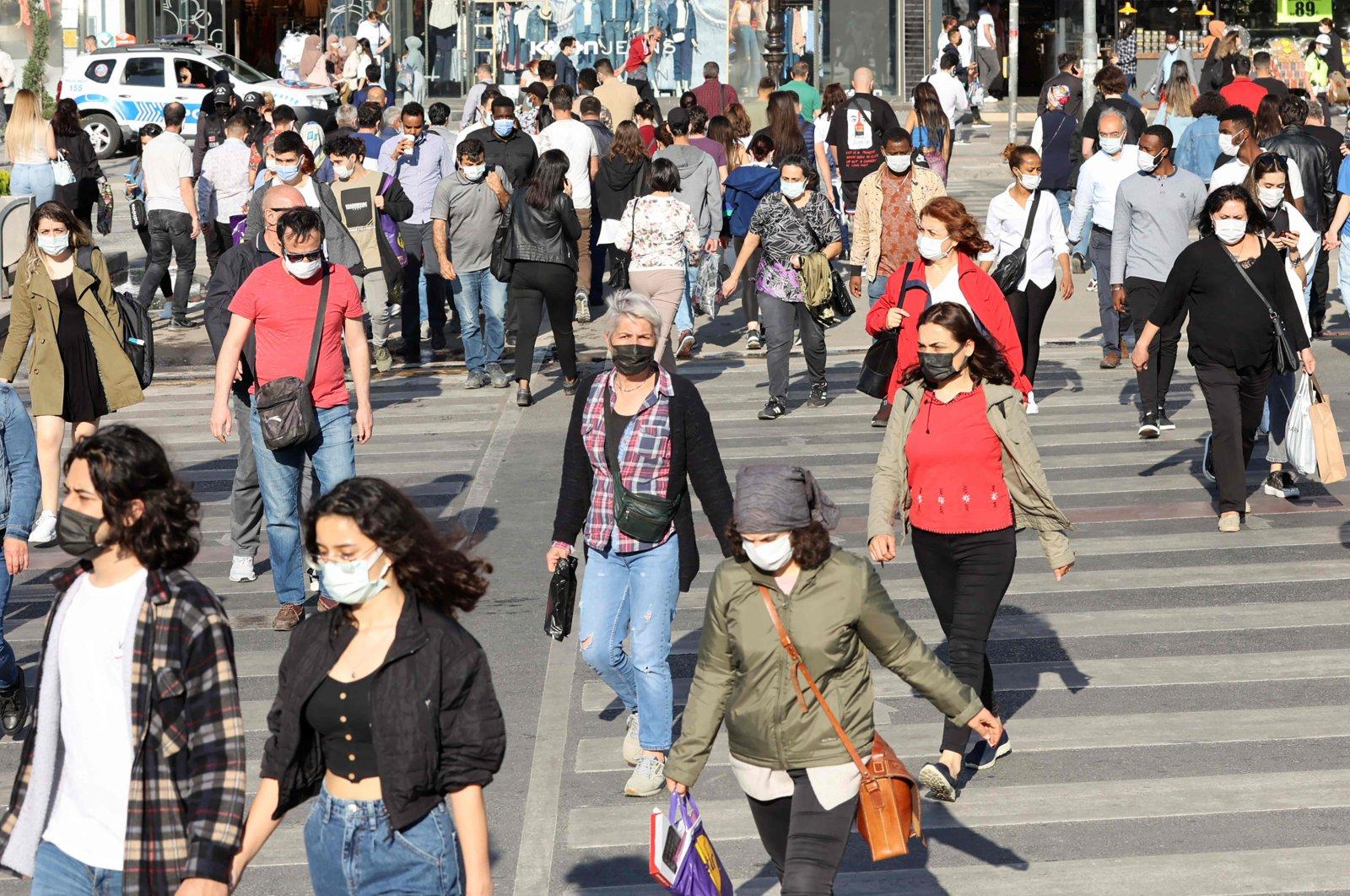 People walk on a street in the capital Ankara, Turkey, May 17, 2021. (AFP Photo)