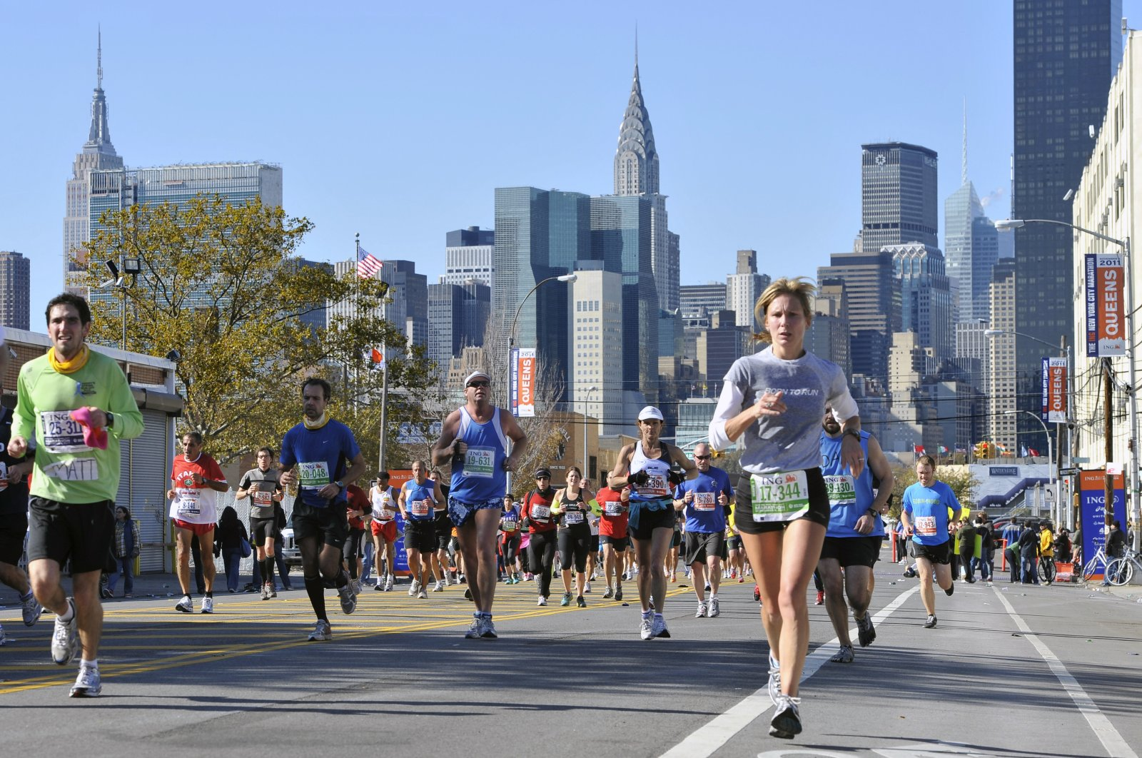 Runners make their way down 44th Drive in the Queens borough of New York during the New York City Marathon, Nov. 6, 2011. (AP Photo)