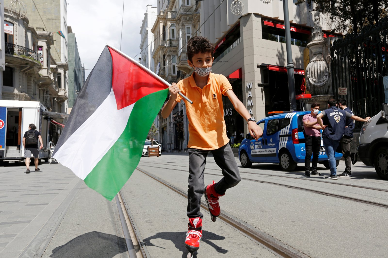 A boy holding a Palestinian flag roller skates in central Istanbul, Turkey, May 16, 2021. (Reuters Photo)