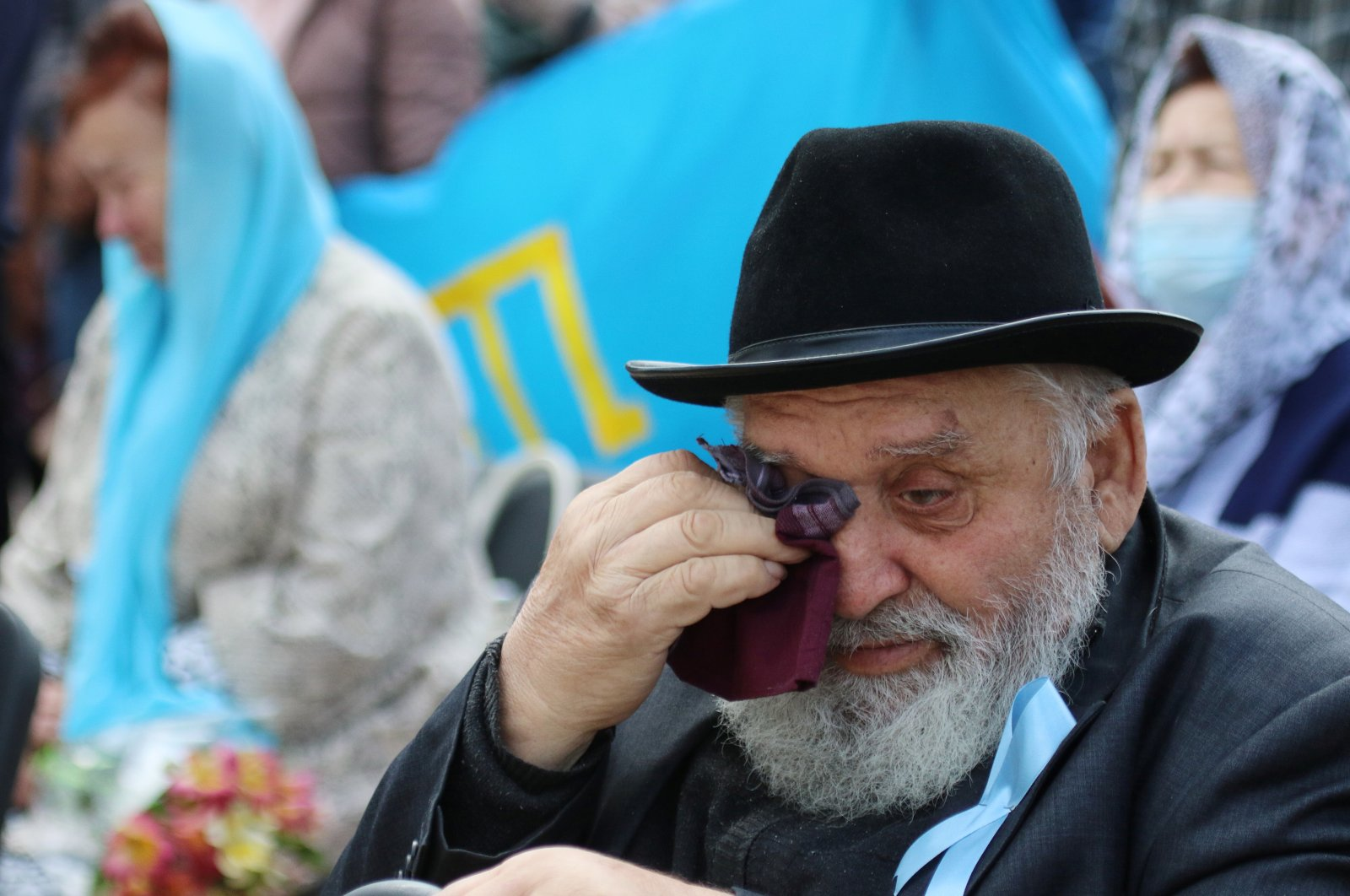A man reacts during a rally marking the anniversary of the mass deportation of Crimean Tatars from the region in 1944, in Yevpatoriya, Crimea, May 18, 2021. (Reuters Photo)