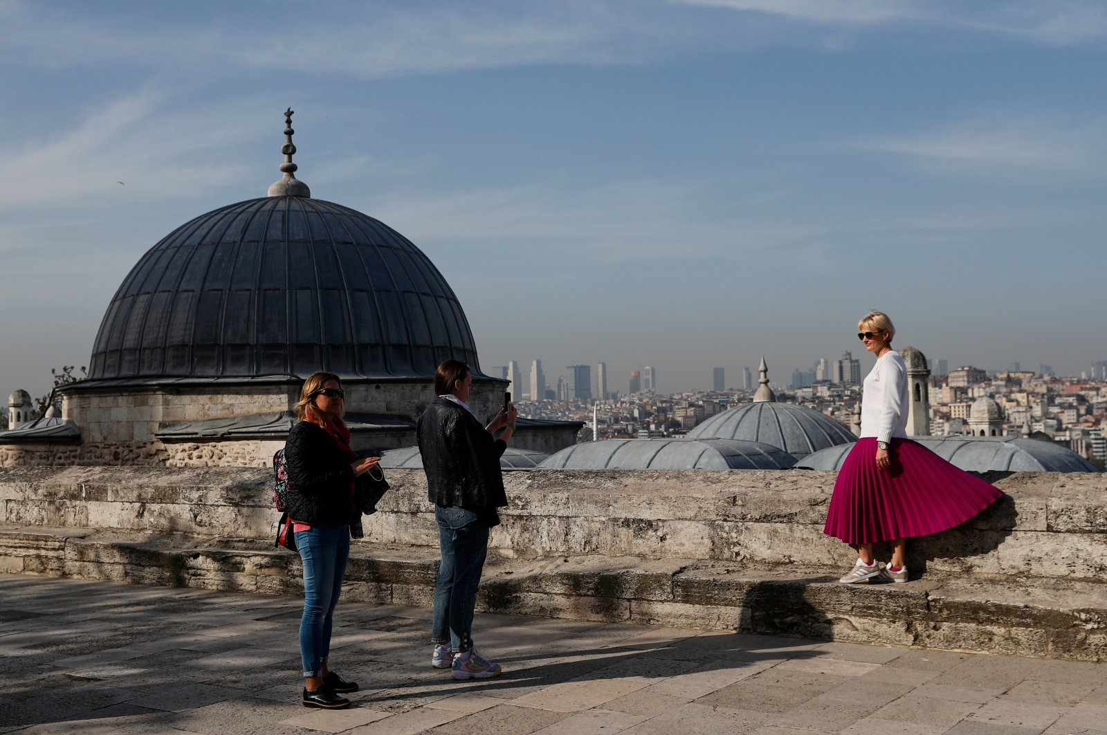 A tourist poses for a souvenir photo at the courtyard of Süleymaniye Mosque in Istanbul, Turkey, April 30, 2021. (Reuters Photo)