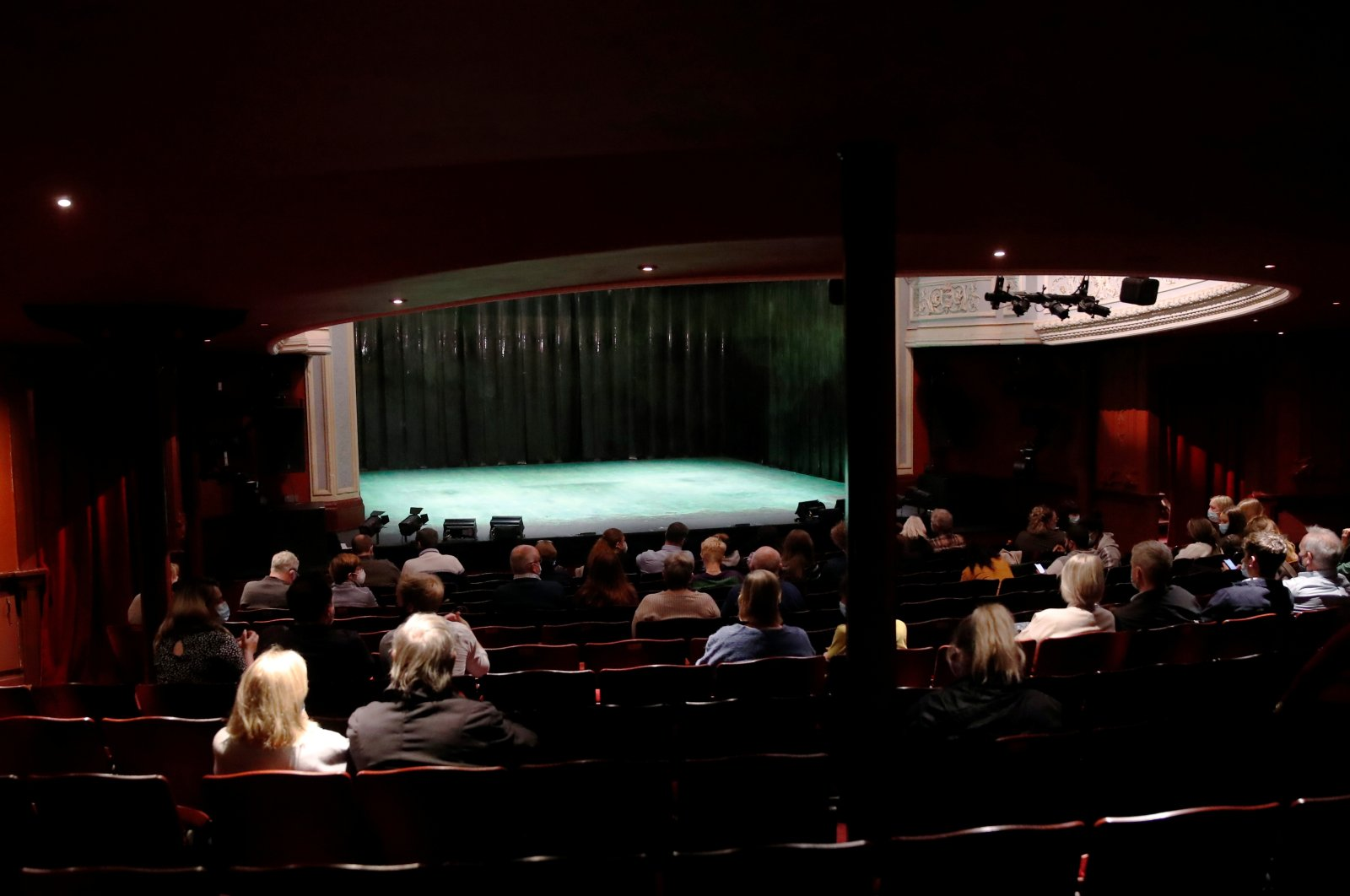 """Members of the audience wait in their seats at the Royal & Derngate for the start of the National Youth Theatre's co-production of """"Animal Farm"""" as COVID-19 restrictions continue to ease, in Northampton, U.K., May 17, 2021. (Reuters Photo)"""