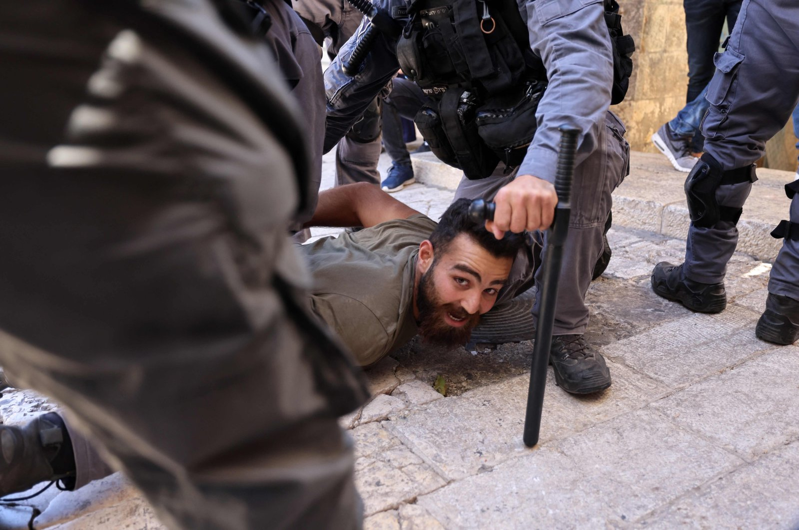 Israeli border police detain a Palestinian man during protests against Israel's occupation and its air campaign on the Gaza strip, at Damascus Gate in East Jerusalem, occupied Palestine, on May 18, 2021. (AFP Photo)