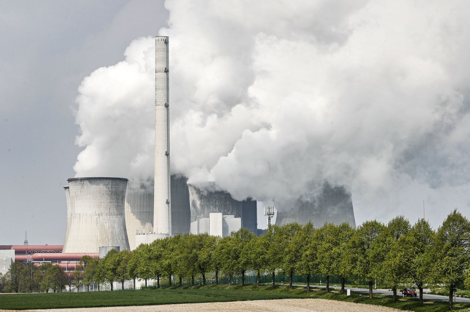 A coal-fired RWE power plant steams on a sunny day in Neurath, Germany, April 29, 2021. (AP Photo)