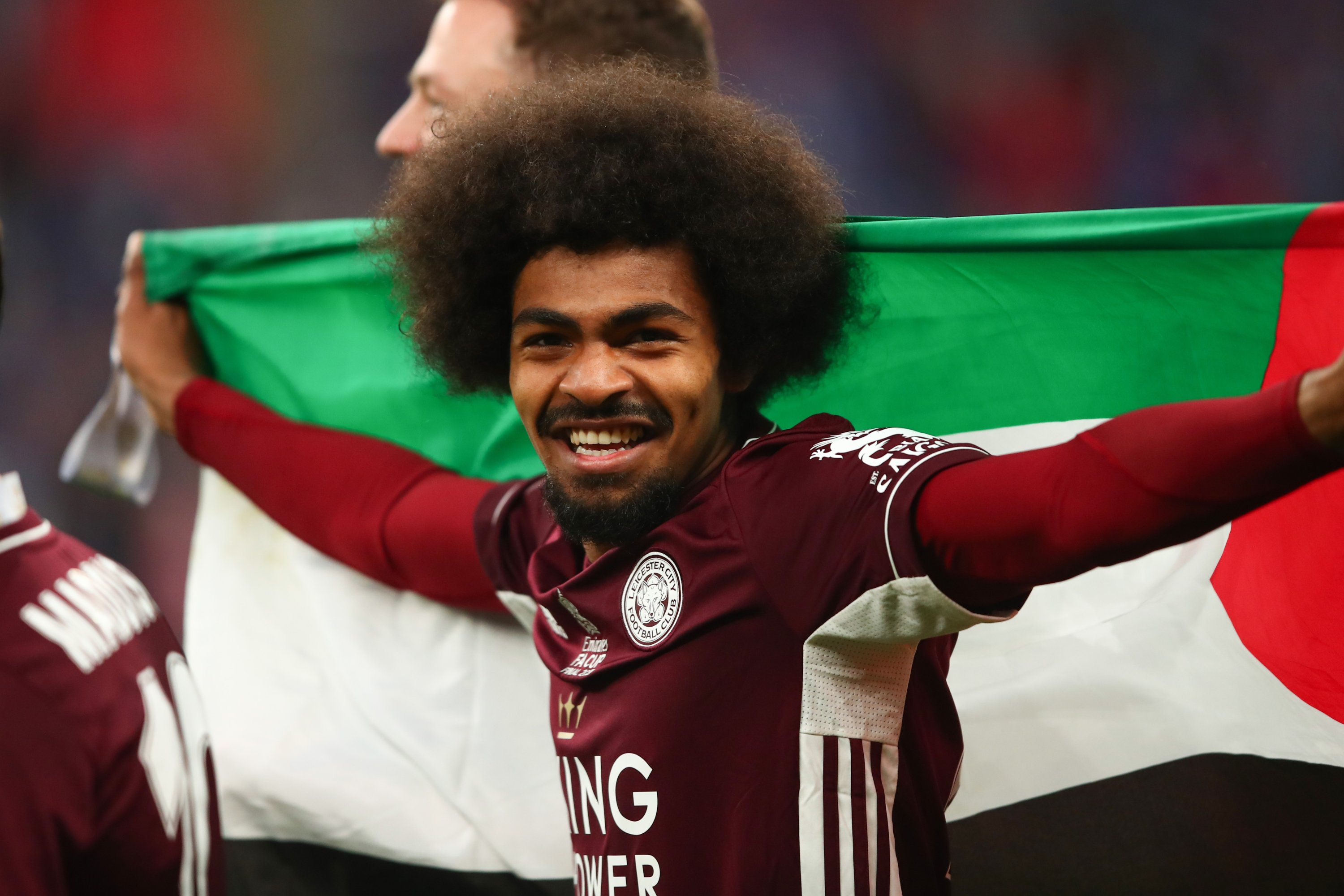 Leicester City's Hamza Choudhury displays a Palestine flag as he celebrates winning the FA Cup at Wembley Stadium, London, England, May 15, 2021. (Getty Images)
