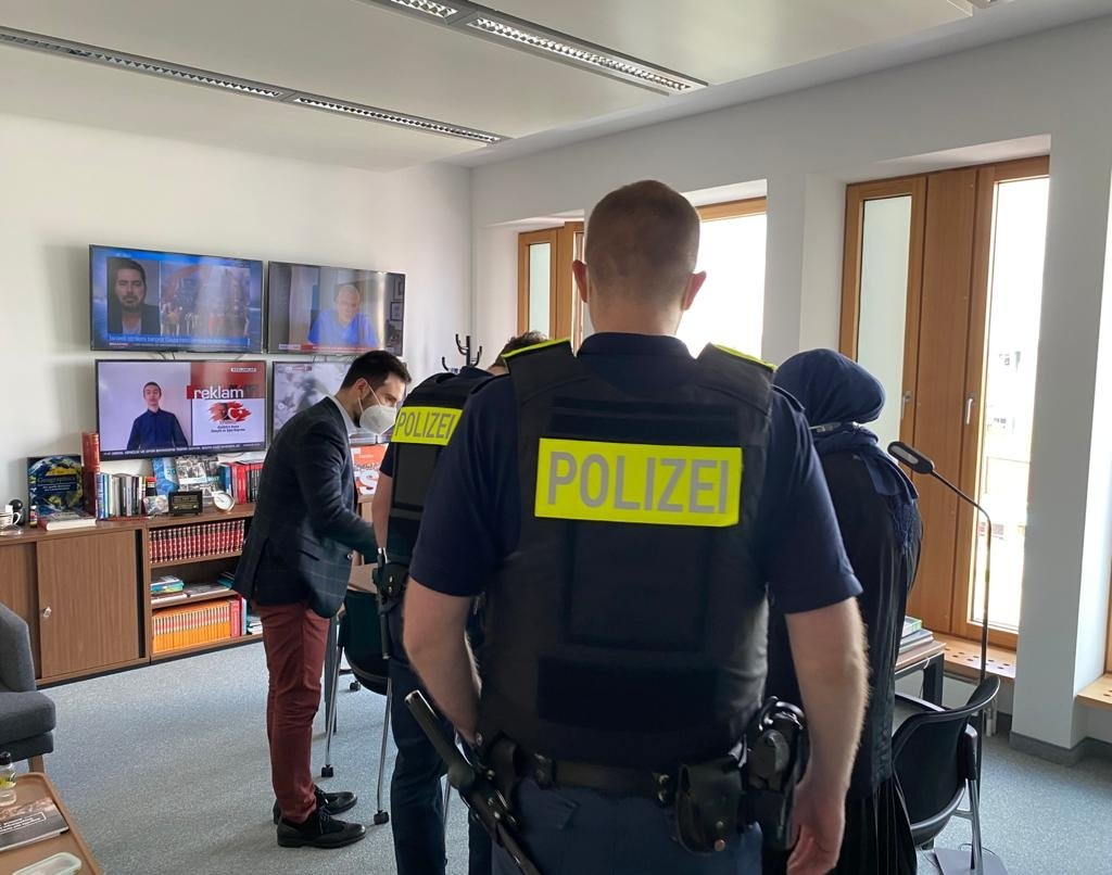 German police receive information from TRT Deutsch officials in the news platform's office in Berlin, Germany, May 19, 2021.