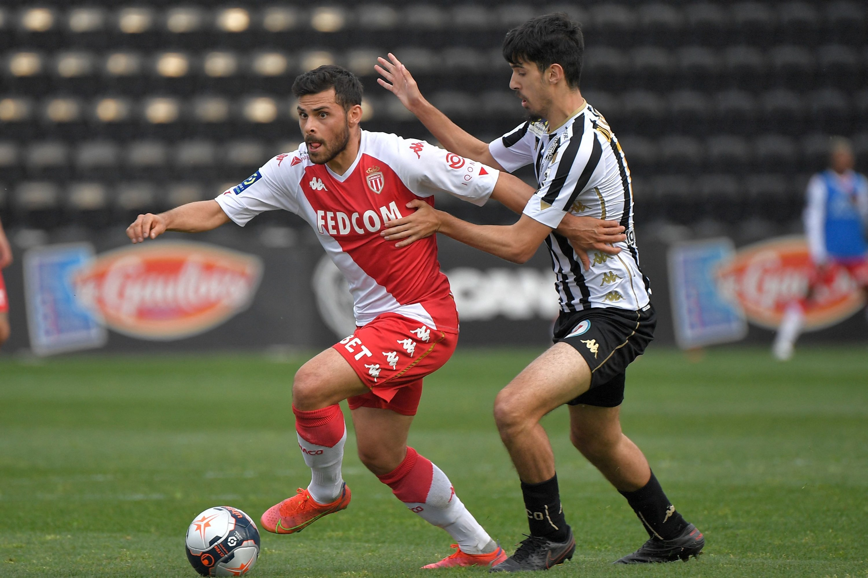Monaco's German forward Kevin Volland (L) fights for the ball with Angers' French midfielder Zinedine Ould Khaled during a French L1 match at the Raymond Kopa Stadium, Angers, France, April 25, 2021. (AFP Photo)