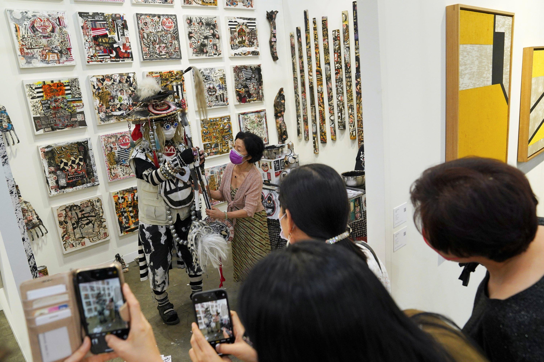 Visitors take pictures of artworks displayed at Art Basel in Hong Kong, China, May 19, 2021. (Reuters Photo)