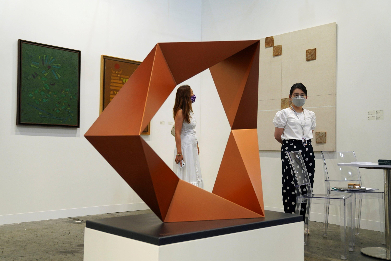 A visitor looks at artworks displayed at Art Basel in Hong Kong, China, May 19, 2021. (Reuters Photo)