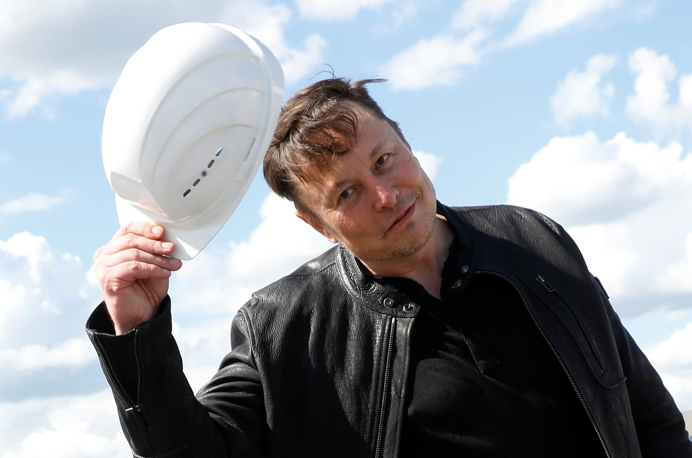 SpaceX founder and Tesla CEO Elon Musk holds a helmet as he visits the construction site of Tesla's gigafactory in Gruenheide, near Berlin, Germany, May 17, 2021. (REUTERS)