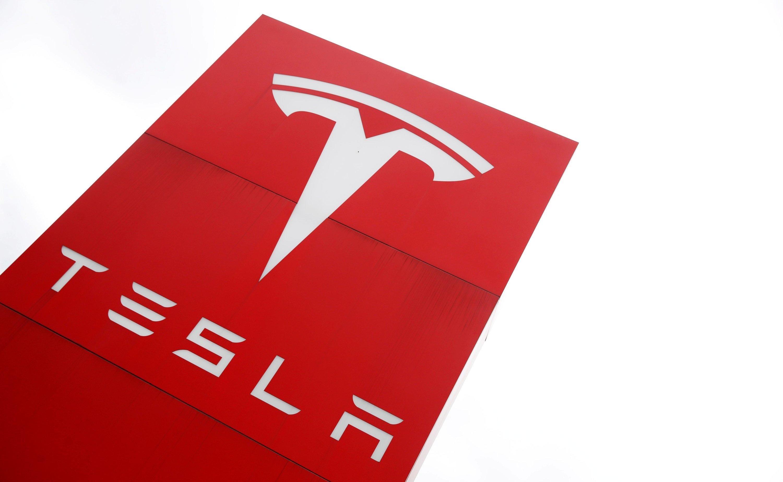 A sign shows Tesla's logo at a car dealership in London, Britain, May 14, 2021. (REUTERS)