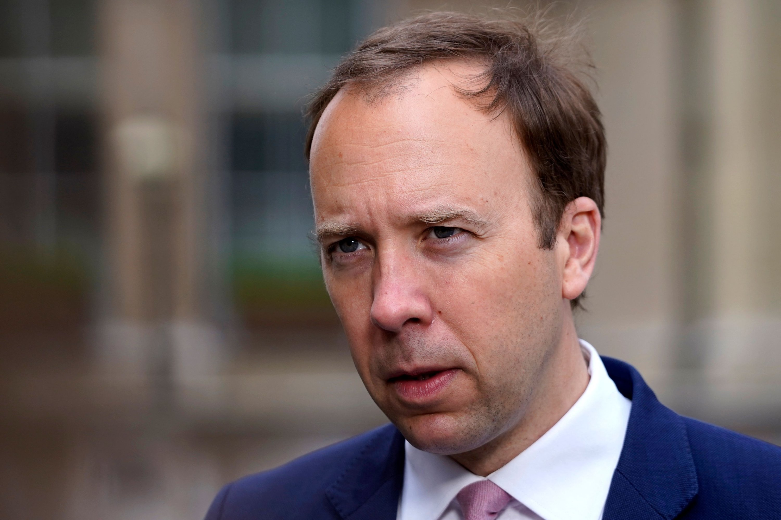 Britain's Health Secretary Matt Hancock gives a media interview as he arrives at the BBC to appear on the political program The Andrew Marr Show, in central London, Britain, May 16, 2021. (AFP)