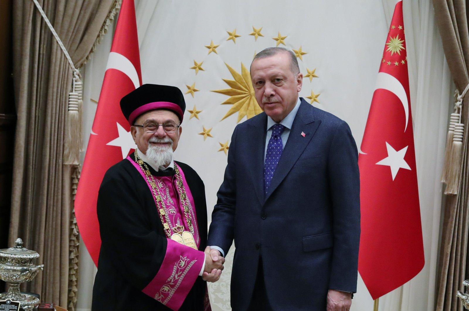 President Recep Tayyip Erdoğan shakes hands with Ishak Haleva, chief rabbi of the Jewish community in Turkey at the Presidential Complex in Ankara, Turkey, Jan. 31, 2020. (AA File Photo)