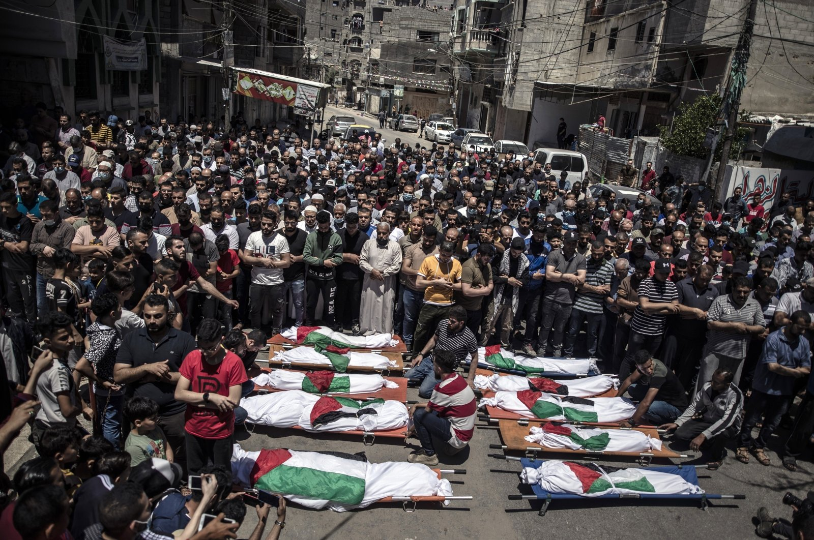 Palestinians attend the funeral of two women and eight children of the Abu Hatab family who were killed after an Israeli airstrike in Gaza City, Gaza Strip, Palestine, May 15, 2021. (AP Photo)