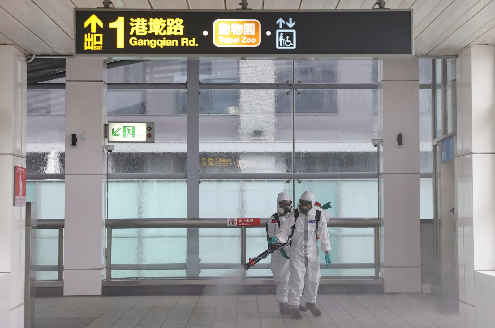 Soldiers in protective suits disinfect a metro station following a surge of COVID-19 infections in Taipei, Taiwan, May 19, 2021. (Reuters Photo)