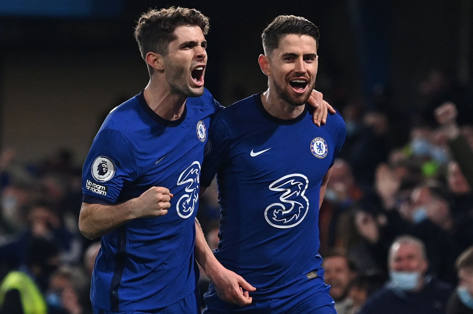 Chelsea midfielder Jorginho (R) celebrates with teammate Christian Pulisic after scoring his team's second goal against Leicester City at Stamford Bridge, London, Britain, May 18, 2021. (AFP Photo)