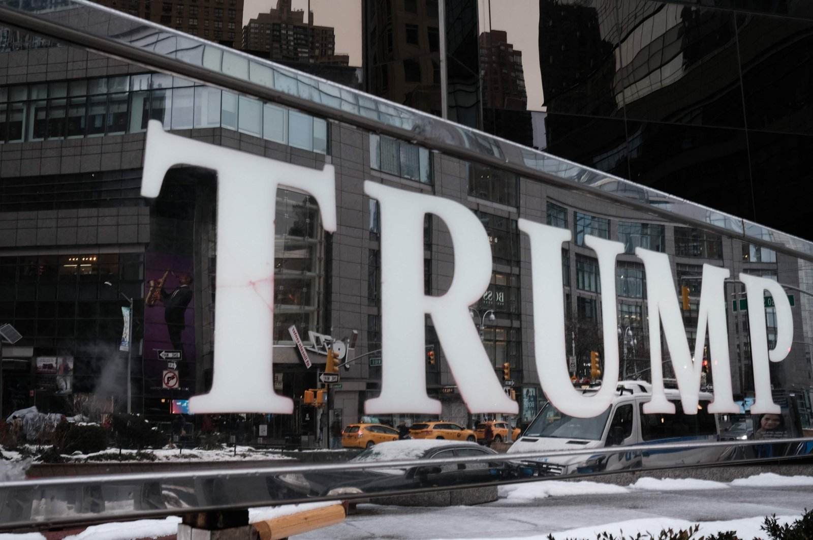 A sign for the Trump International Hotel stands in New York City as the impeachment trial of Donald Trump begins in Washington, D.C., U.S., February 9, 2021. (AFP Photo)