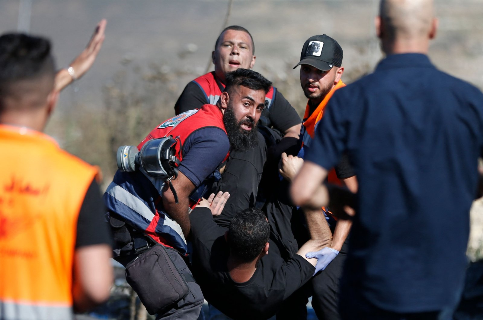Palestinian paramedics evacuate a wounded protester injured by Israeli security forces near the settlement of Beit El and Ramallah in the occupied West Bank, Palestine, on May 17, 2021. (AFP Photo)