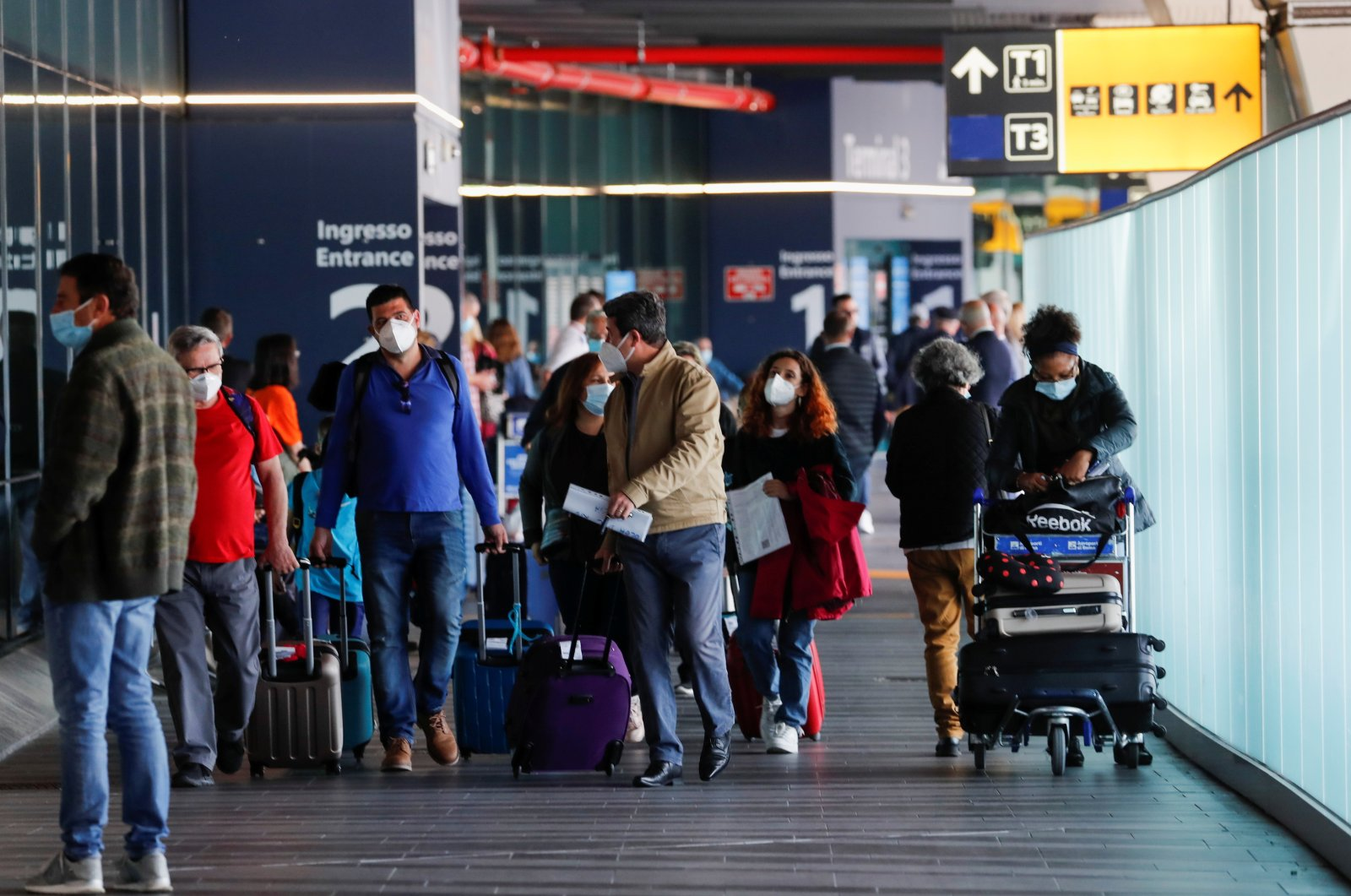 Travelers walk with their luggage at Fiumicino Airport near Rome, Italy, May 17, 2021. (Reuters Photo)