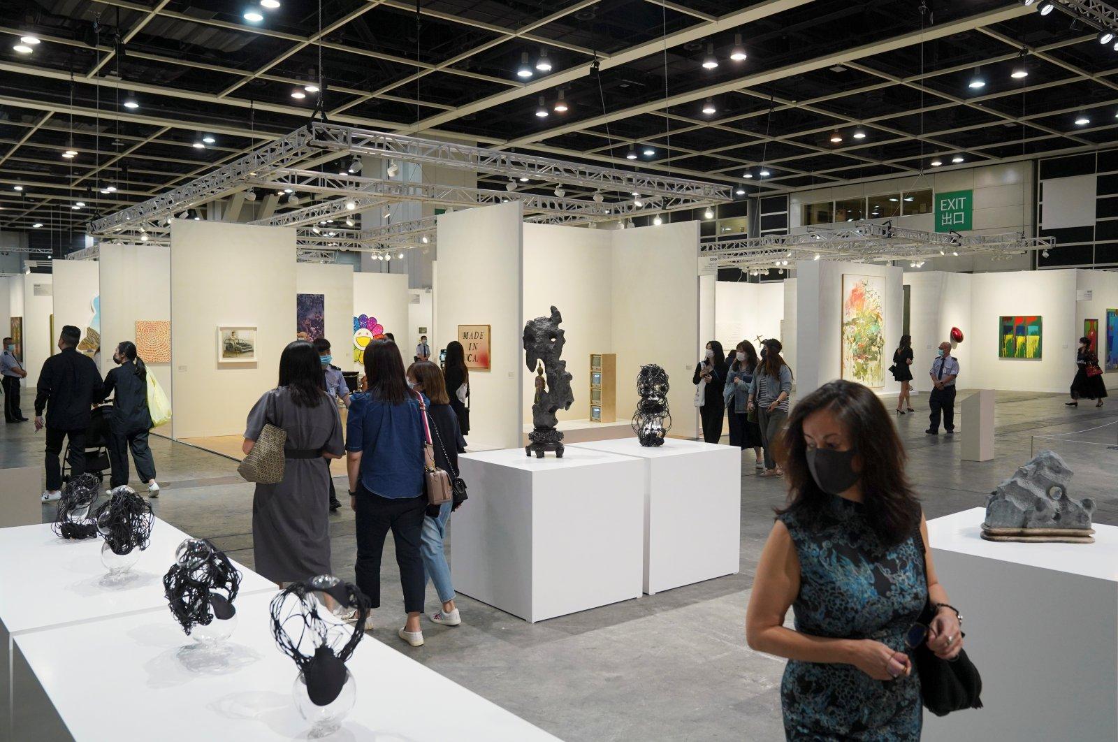 Visitors look at artworks displayed at Art Basel in Hong Kong, China, May 19, 2021. (Reuters Photo)