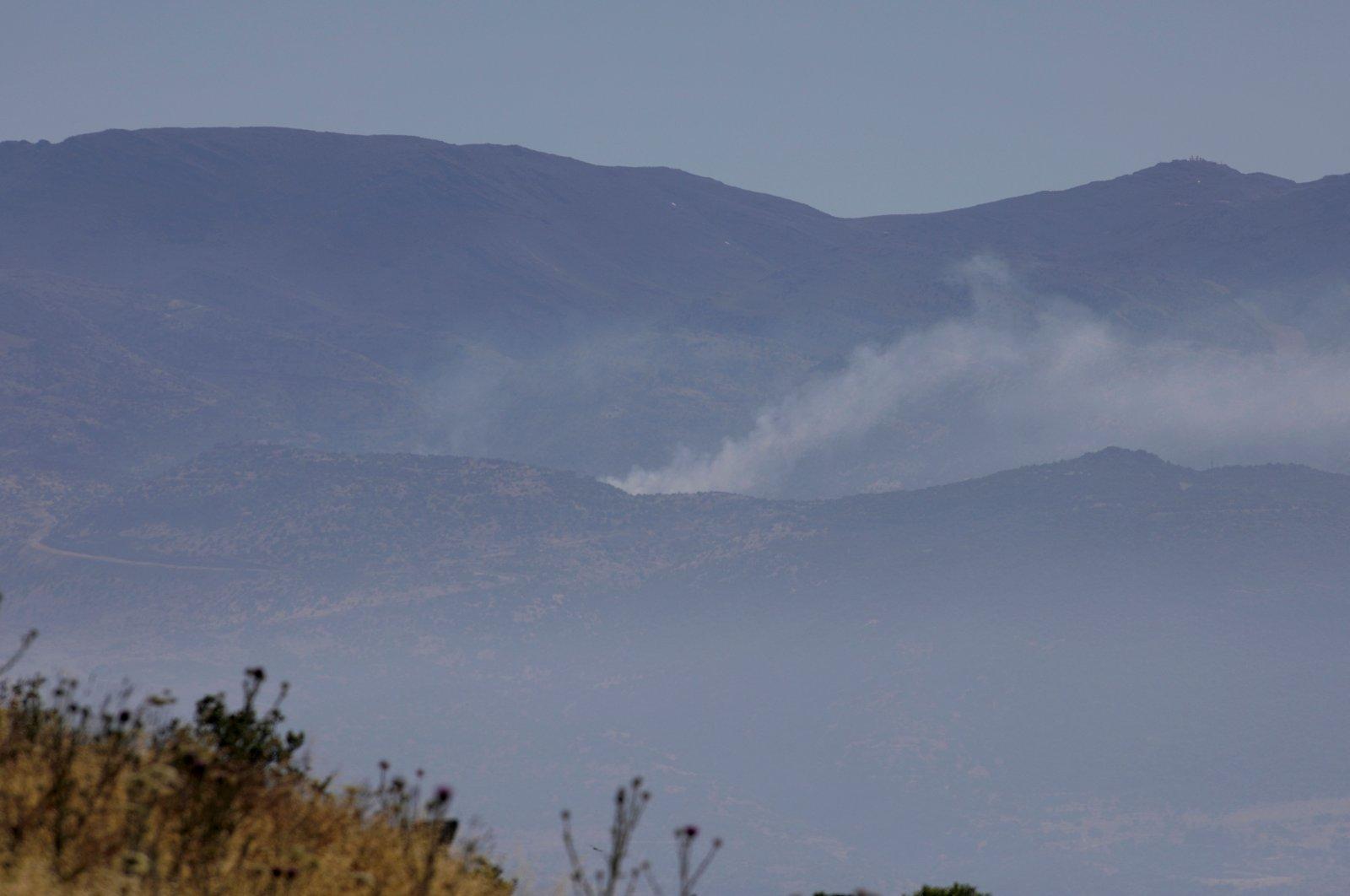 Smoke billows from the southern Lebanese border village of Kfar Shuba in this photo taken from the northern Israeli Kibbutz of Misgav Am, Israel,May 18, 2021.(AFP Photo)
