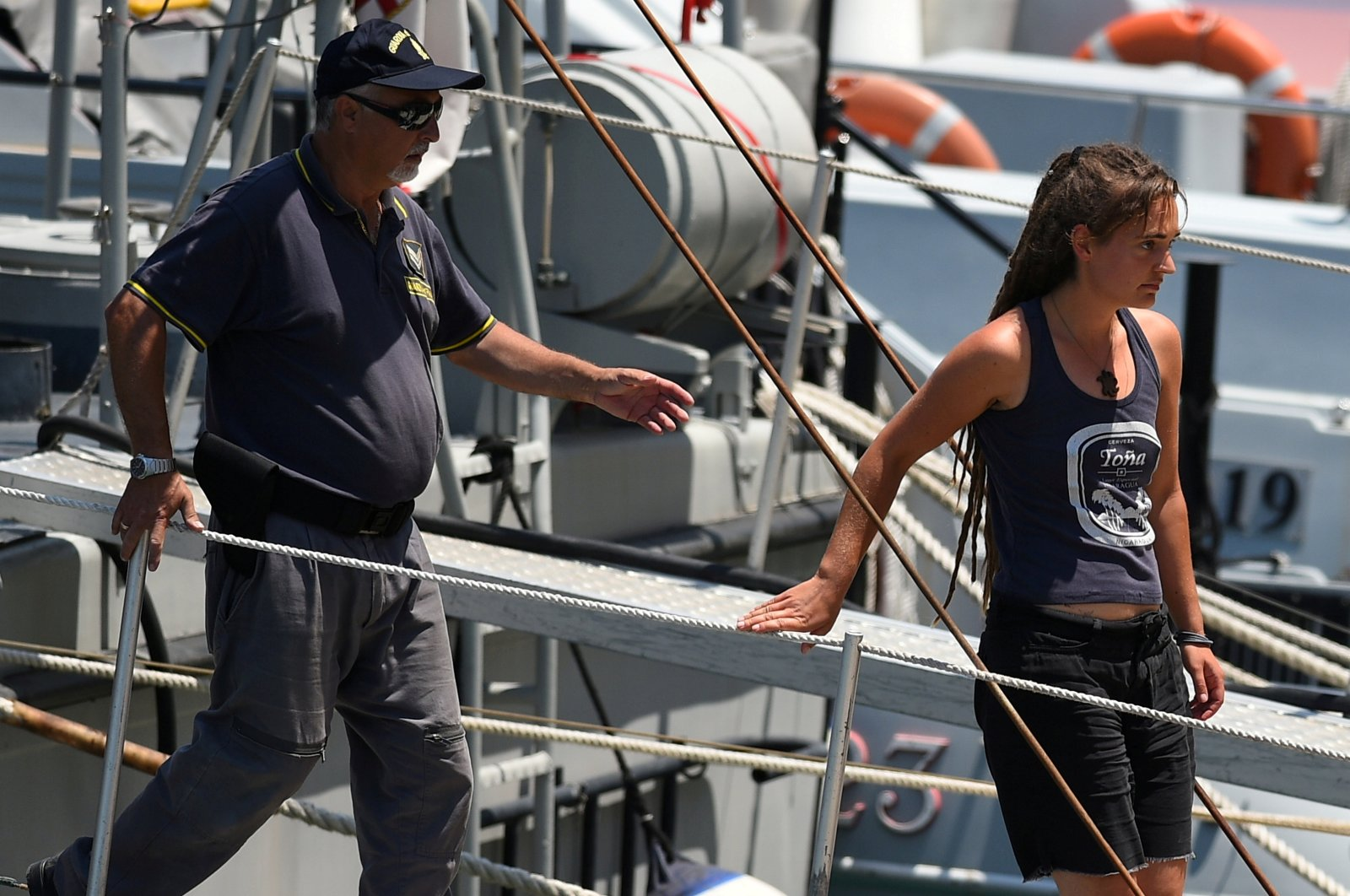 Carola Rackete, Sea-Watch 3 captain, disembarks from a Finance police boat, in Porto Empedocle, Italy July 1, 2019. (REUTERS File Photo)
