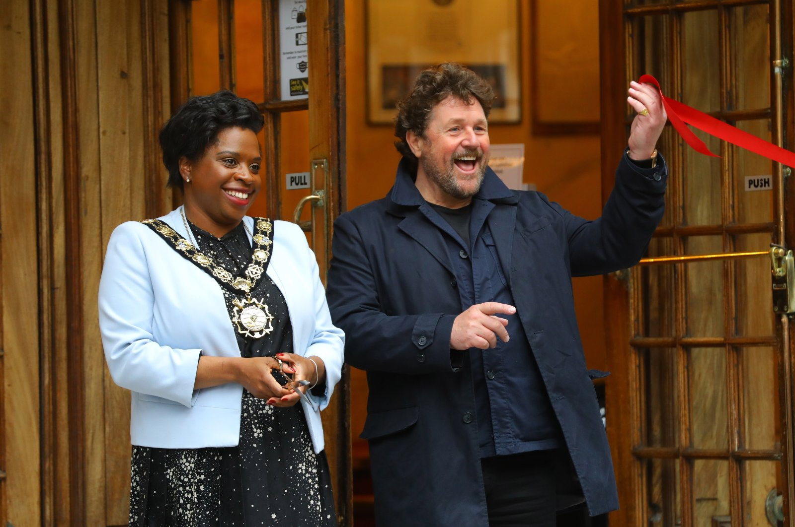 Mayor of Camden Sabrina Francis (L) and actor Michael Ball officially open St. Martin's Theatre in London, Britain, May 17, 2021. (EPA)